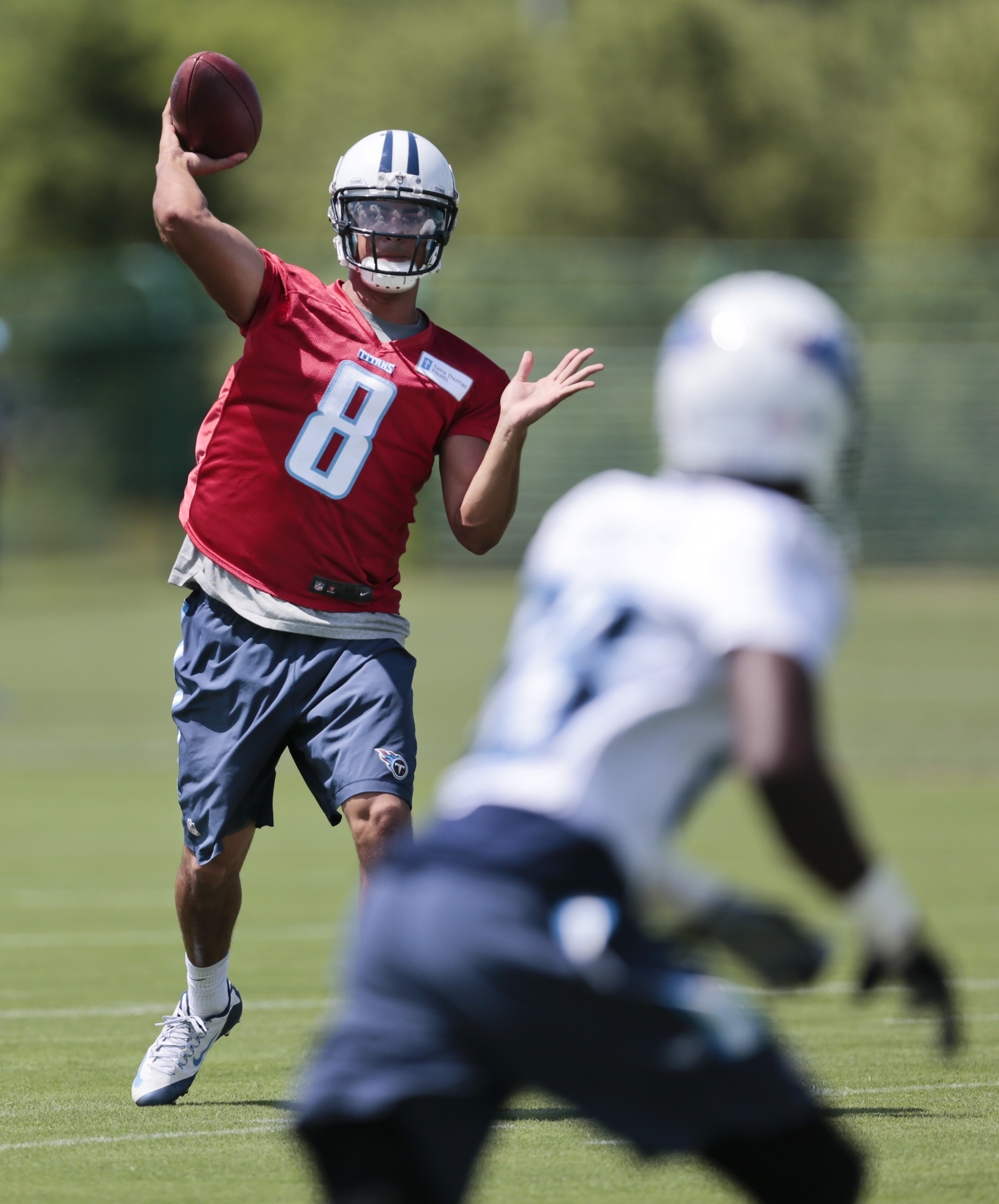 Tennessee Titans quarterback Marcus Mariota (8) passes during NFL football minicamp on Tuesday, June 16, 2015, in Nashville, Tenn. (AP Photo/Mark Humphrey)
