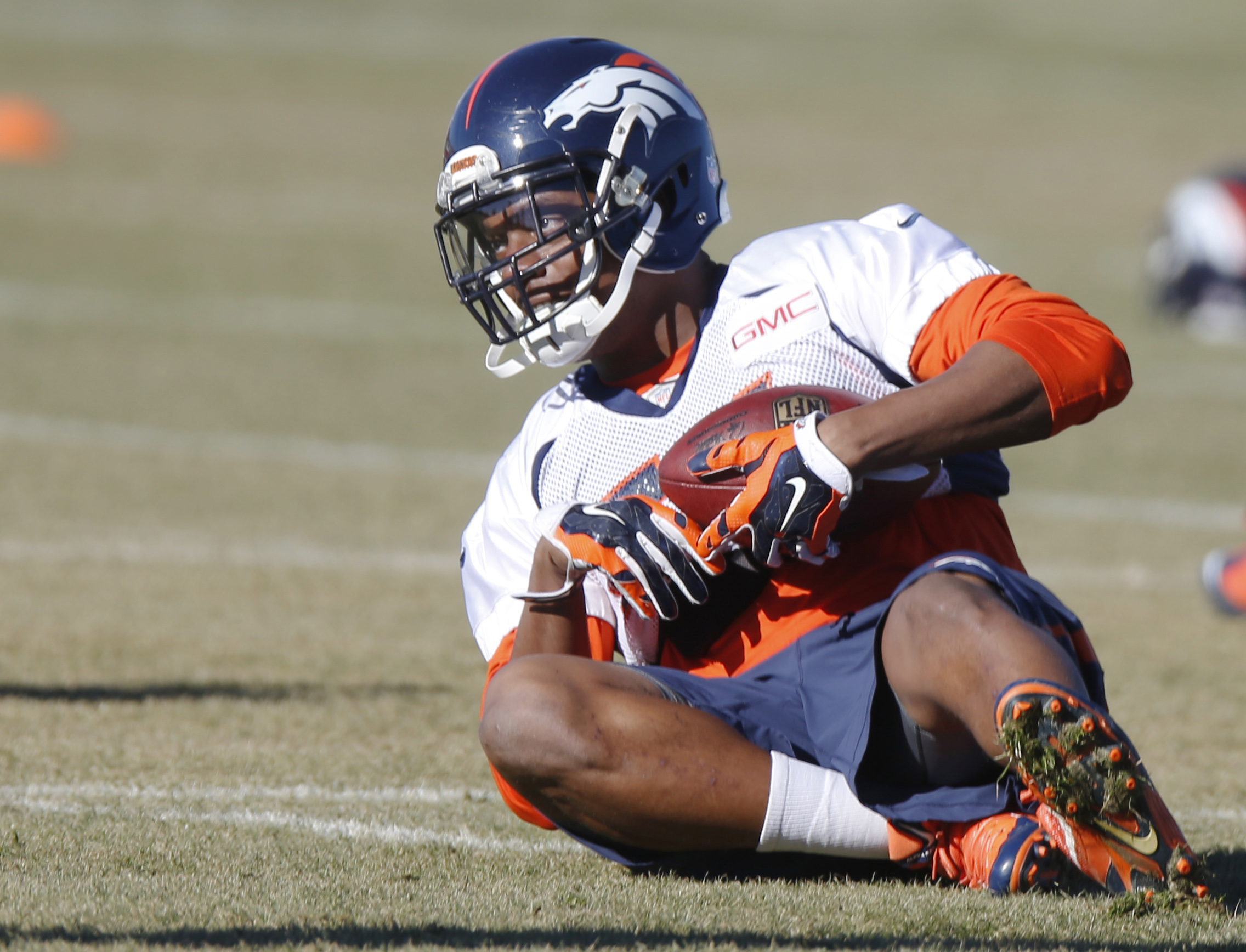 FILE - In this Jan, 8, 2015, file photo, Denver Broncos linebacker Brandon Marshall covers a fumble as part of a drill during a team practice for an NFL football divisional playoff game against the Indianapolis Colts in Englewood, Colo. Marshall like his