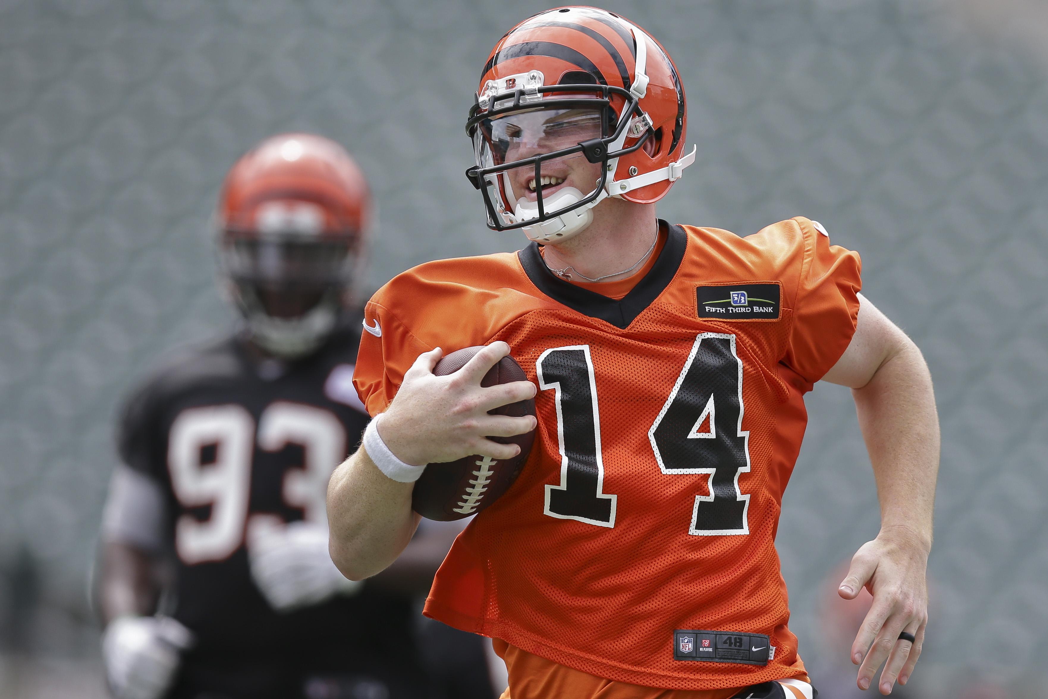 Cincinnati Bengals quarterback Andy Dalton runs a drill during an NFL football minicamp at Paul Brown Stadium in Cincinnati, Wednesday, June 17, 2015. (AP Photo/John Minchillo)