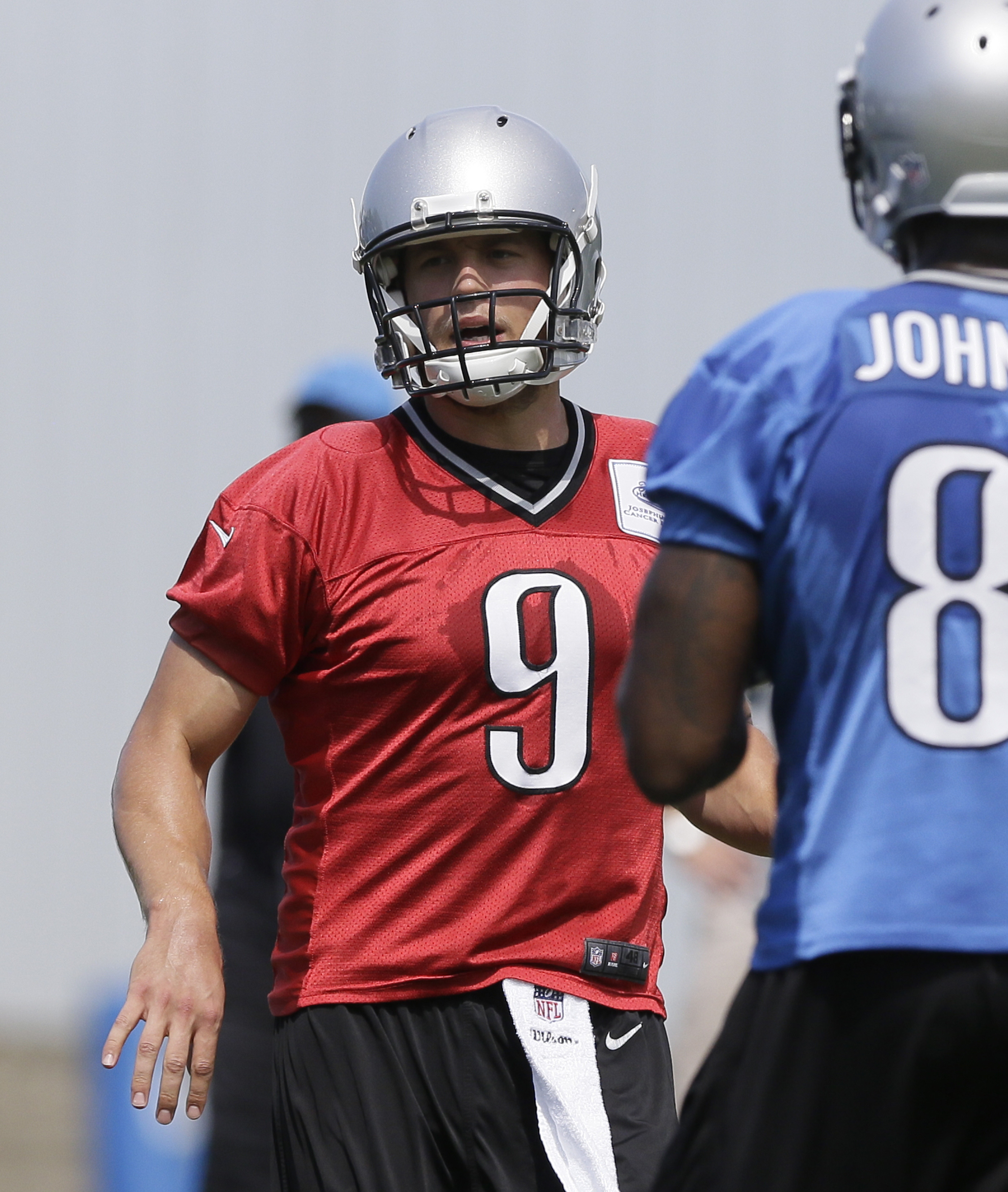 In this photo taken on June 16, 2015, Detroit Lions quarterback Matthew Stafford huddles during drills at NFL football minicamp, in Allen Park, Mich. The narrative surrounding Stafford's career might have changed significantly if the Detroit had held on t