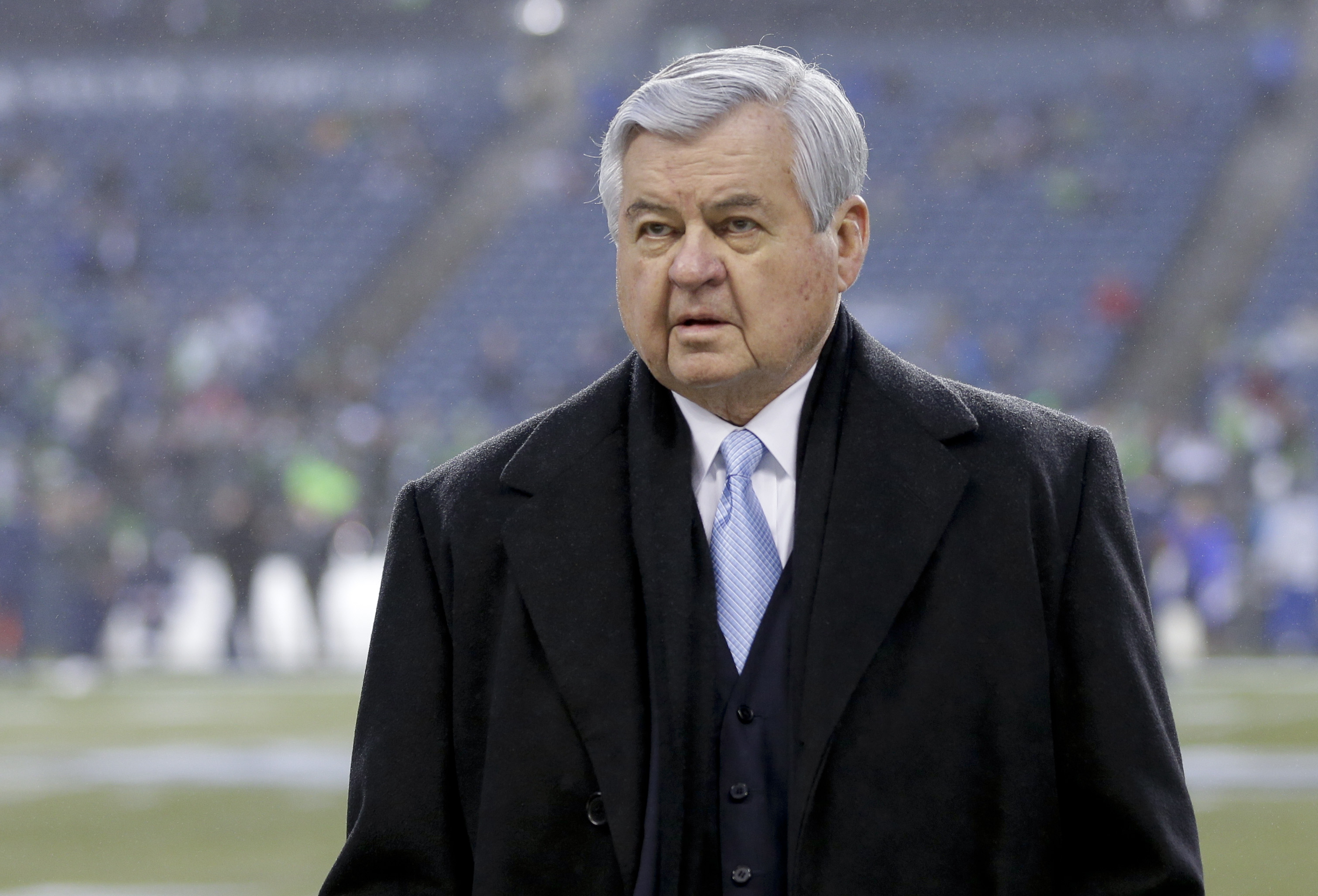 Carolina Panthers owner Jerry Richardson walks on the field before an NFL divisional playoff football game against the Seattle Seahawks in Seattle, Saturday, Jan. 10, 2015. (AP Photo/Ted S. Warren)