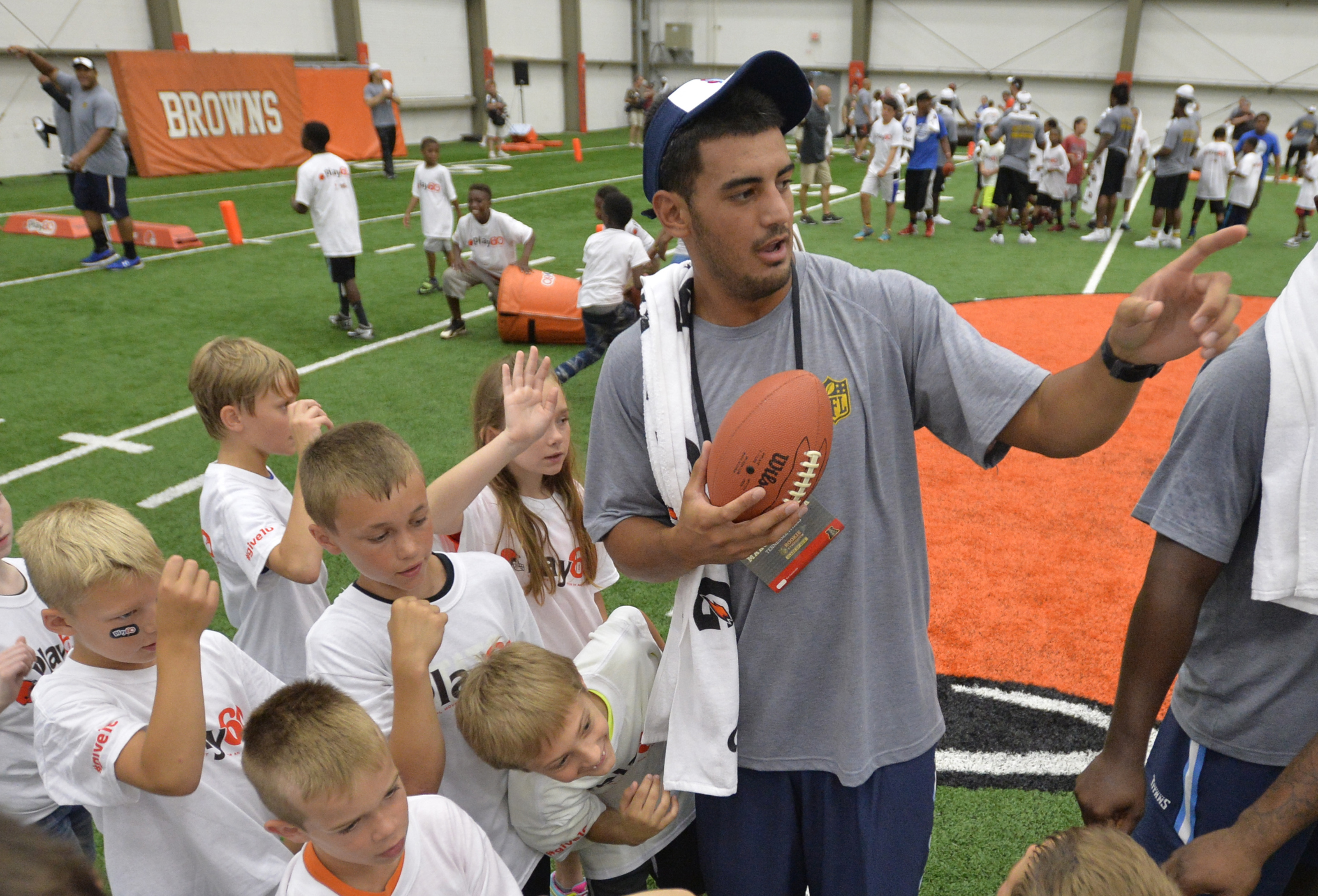 Tennessee Titans quarterback Marcus Mariota explains a football drill to students during the NFL Rookie Symposium in Berea, Ohio, Tuesday, June 23, 2015. (AP Photo/David Richard)