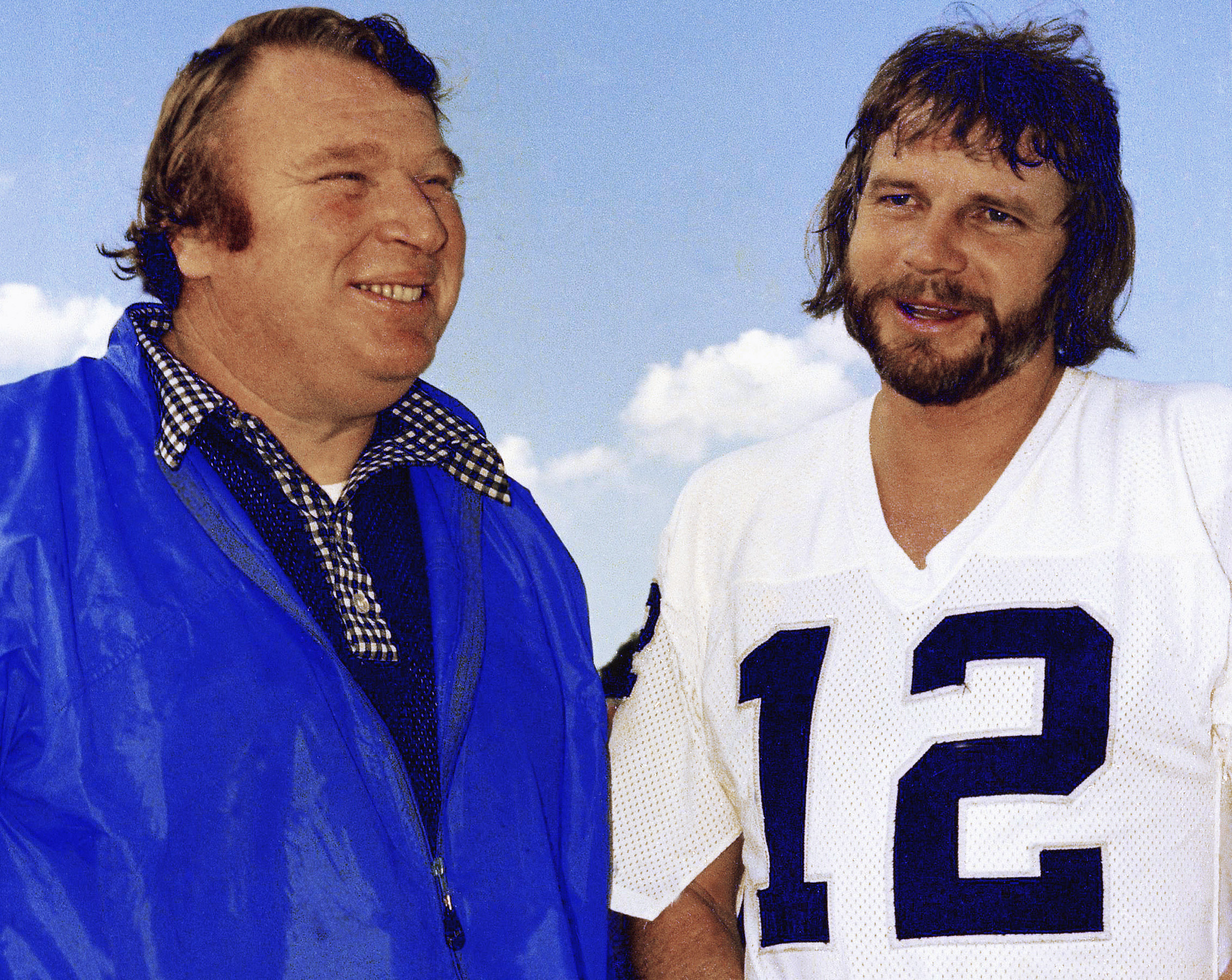 FILE - In this Jan. 4, 1977, file photo, Oakland Raiders quarterback Ken Stabler, right, talks with coach John Madden in Oakland, Calif. Stabler, who led the Raiders to a Super Bowl victory and was the NFL's Most Valuable Player in 1974, has died as a res