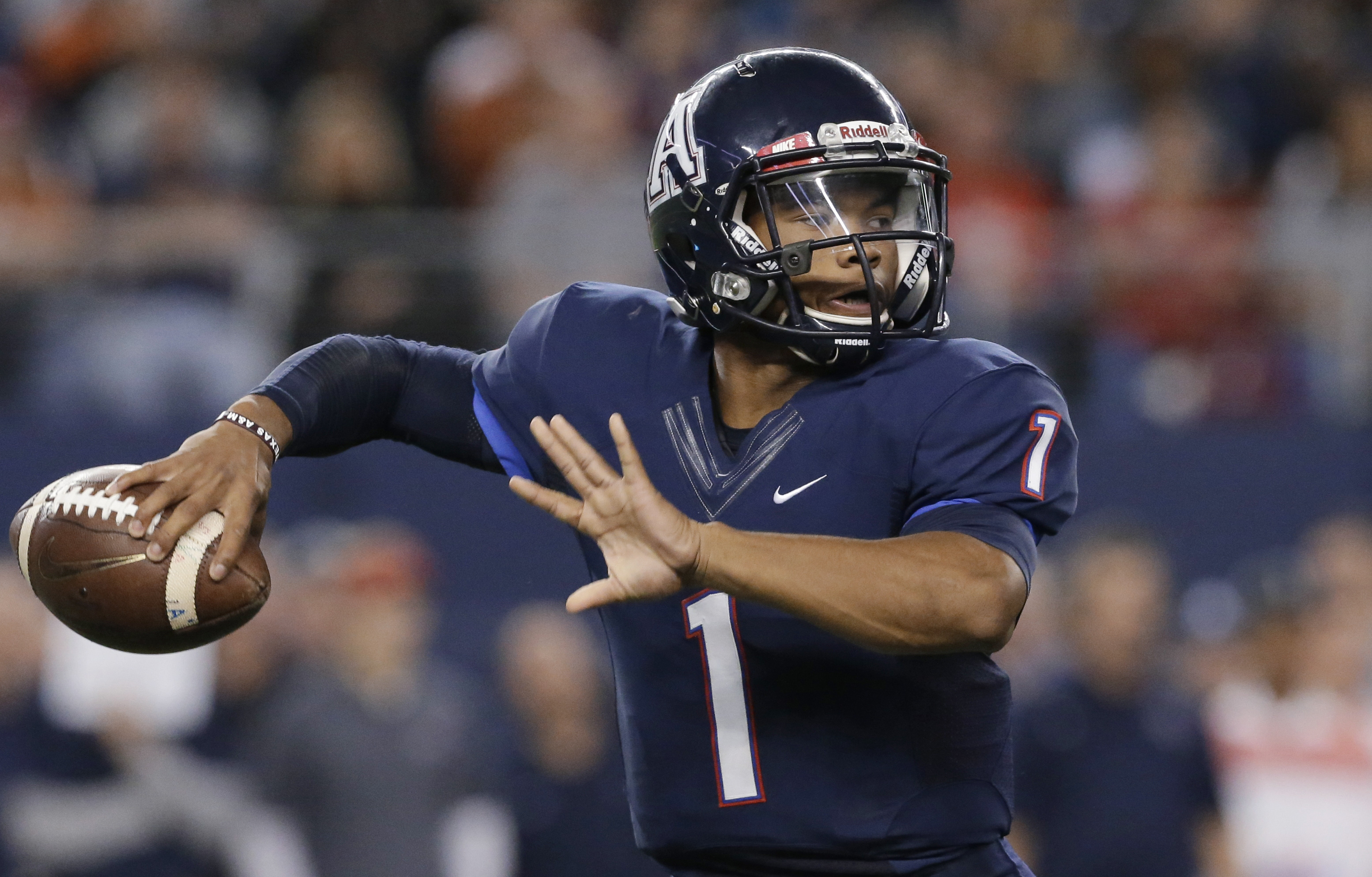FILE - In this Dec. 20, 2014, file photo, Allen quarterback Kyler Murray prepares to pass during the UIL 6A Division I state championship football game against Cypress Ranch in Arlington, Texas. Murray was honored as male national prep athlete of the year