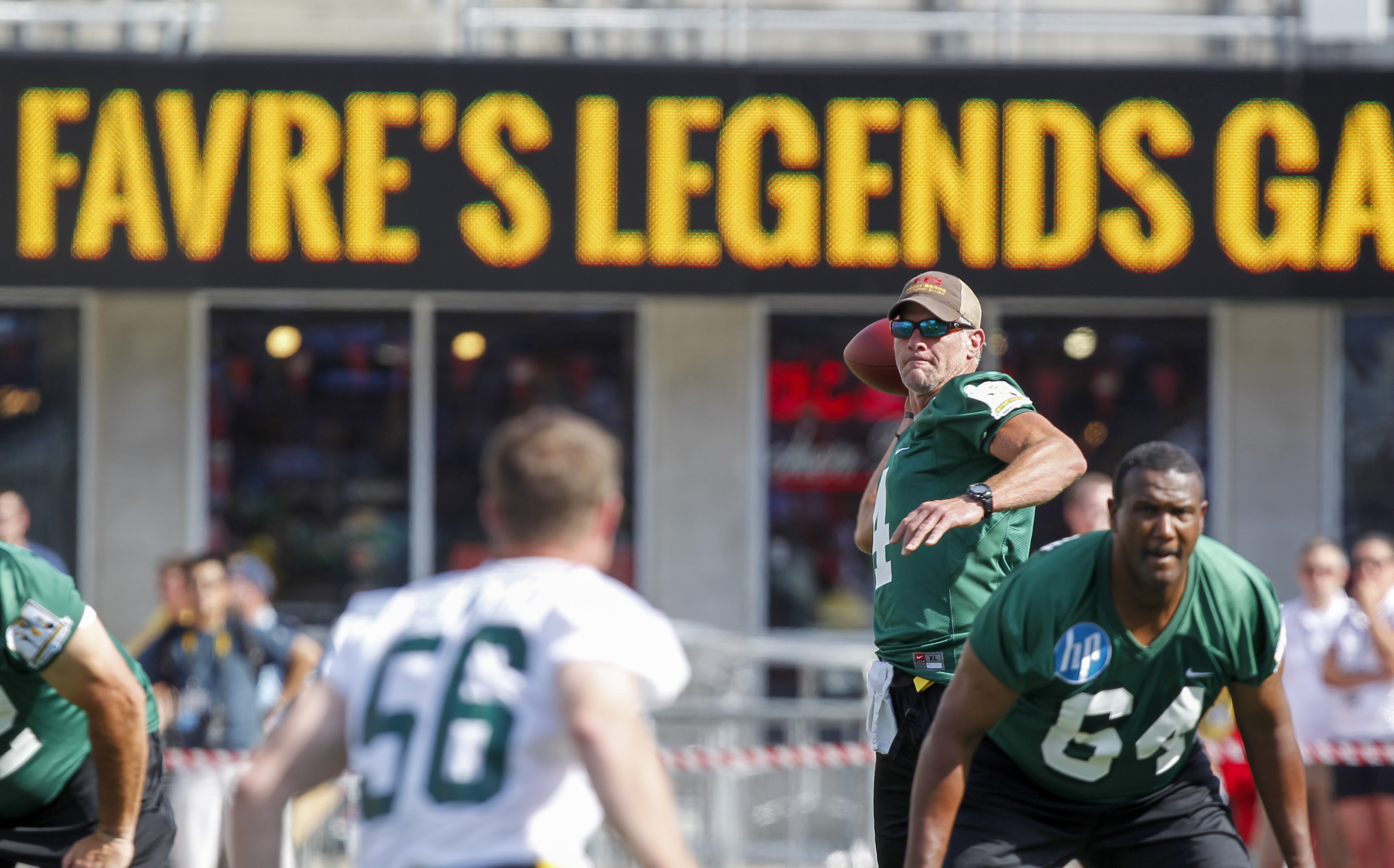 Former Green Bay Parkers quarterback Brett Farve looks to pass during the first half of Brett Favre's Legends Game in a flag football game Sunday, July 19, 2015, at Camp Randall Stadium in Madison, Wis. (AP Photo/Andy Manis)