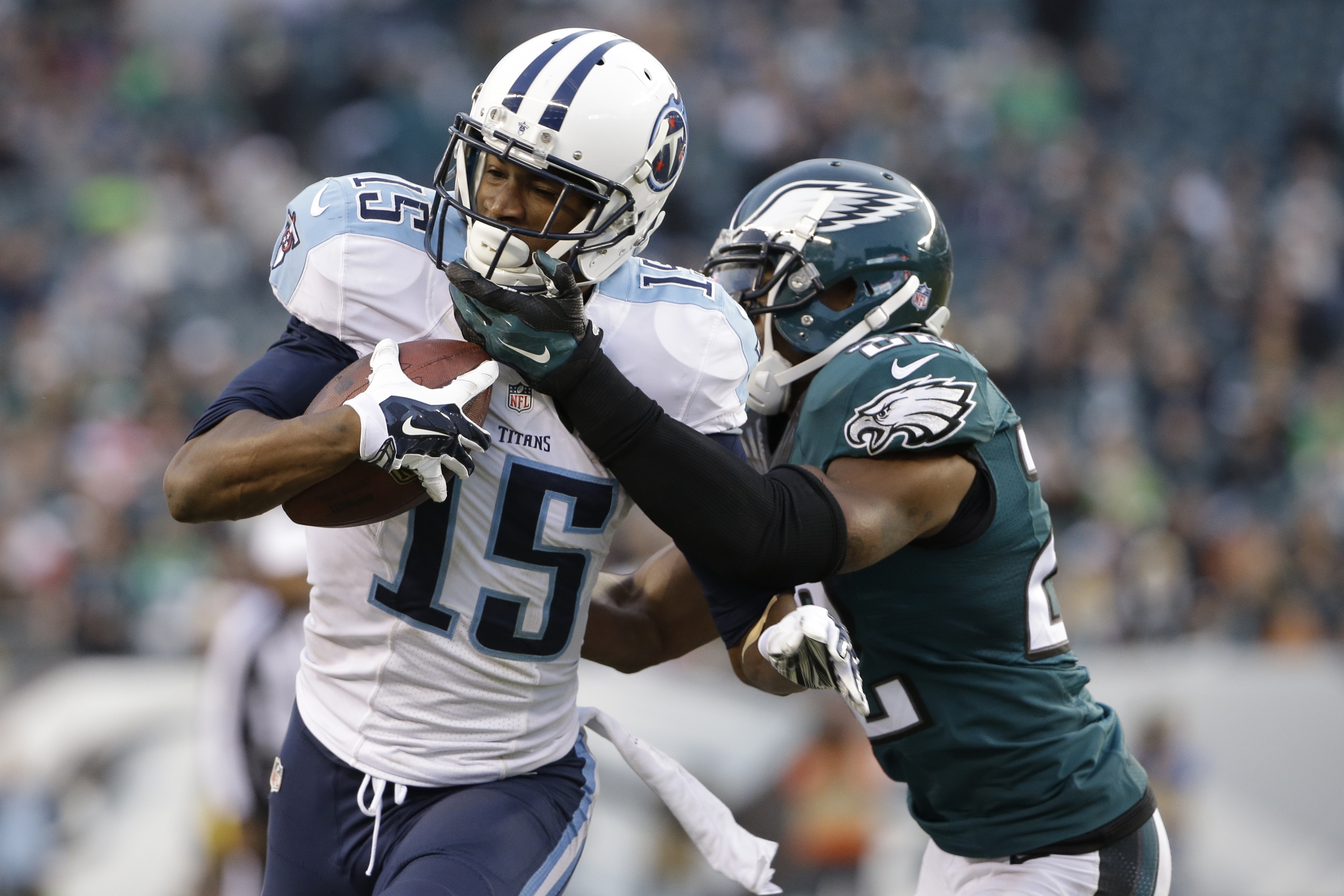 FILE- In this Nov. 23, 2014, file photo, Tennessee Titans' Justin Hunter, left, is tackled by Philadelphia Eagles' Brandon Boykin during the second half of an NFL football game in Philadelphia. Hunter was booked into his hometown jail at the Virginia Beac