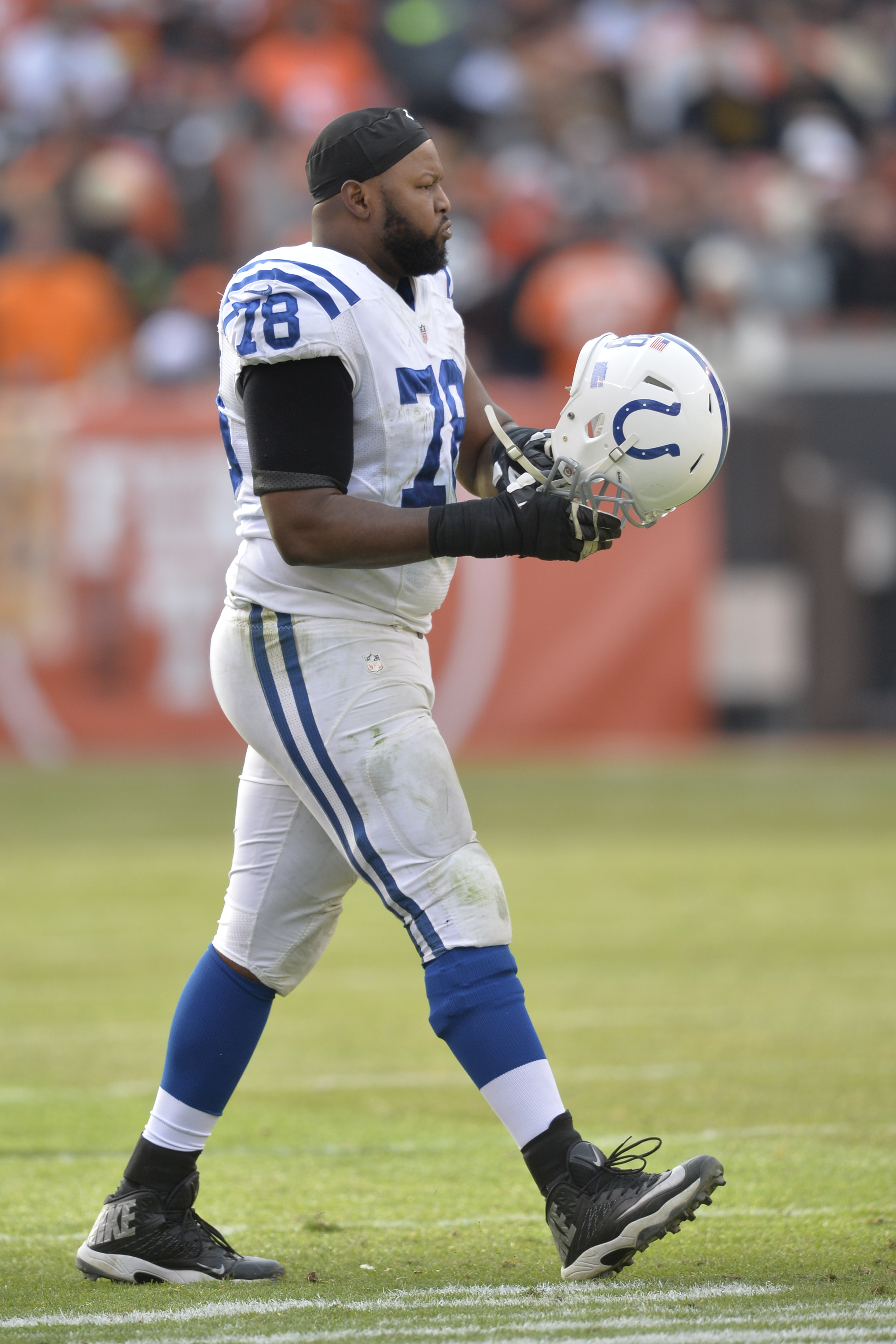 Indianapolis Colts tackle Gosder Cherilus walks on the field against the Cleveland Browns during an NFL football game Sunday, Dec. 7, 2014, in Cleveland. The Colts won 25-24. (AP Photo/David Richard)