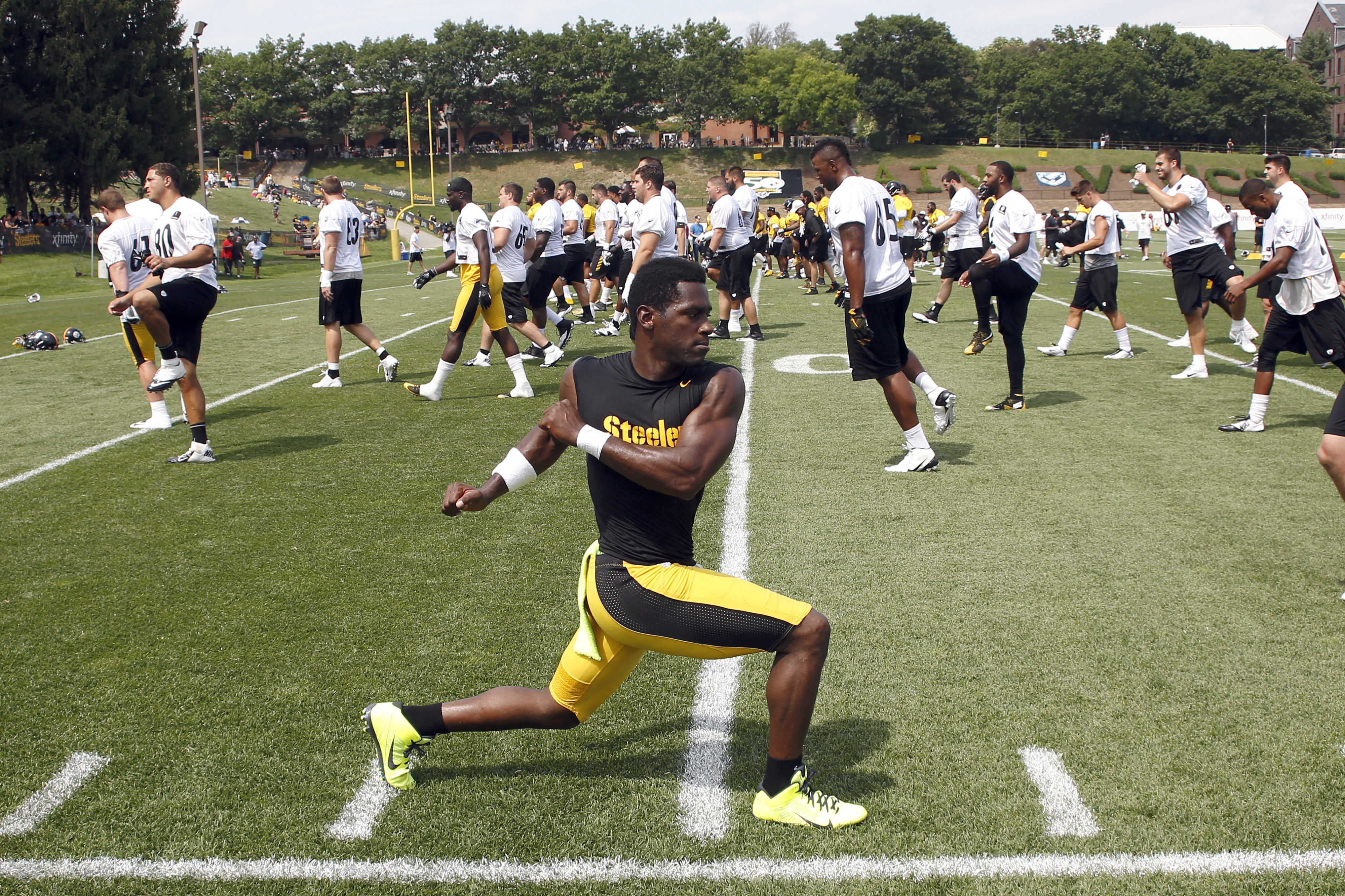 Pittsburgh Steelers wide receiver Antonio Brown (84) twists as he warms up with the team during practice at NFL football training camp in Latrobe, Pa. on Sunday, July 26, 2015 . (AP Photo/Keith Srakocic)