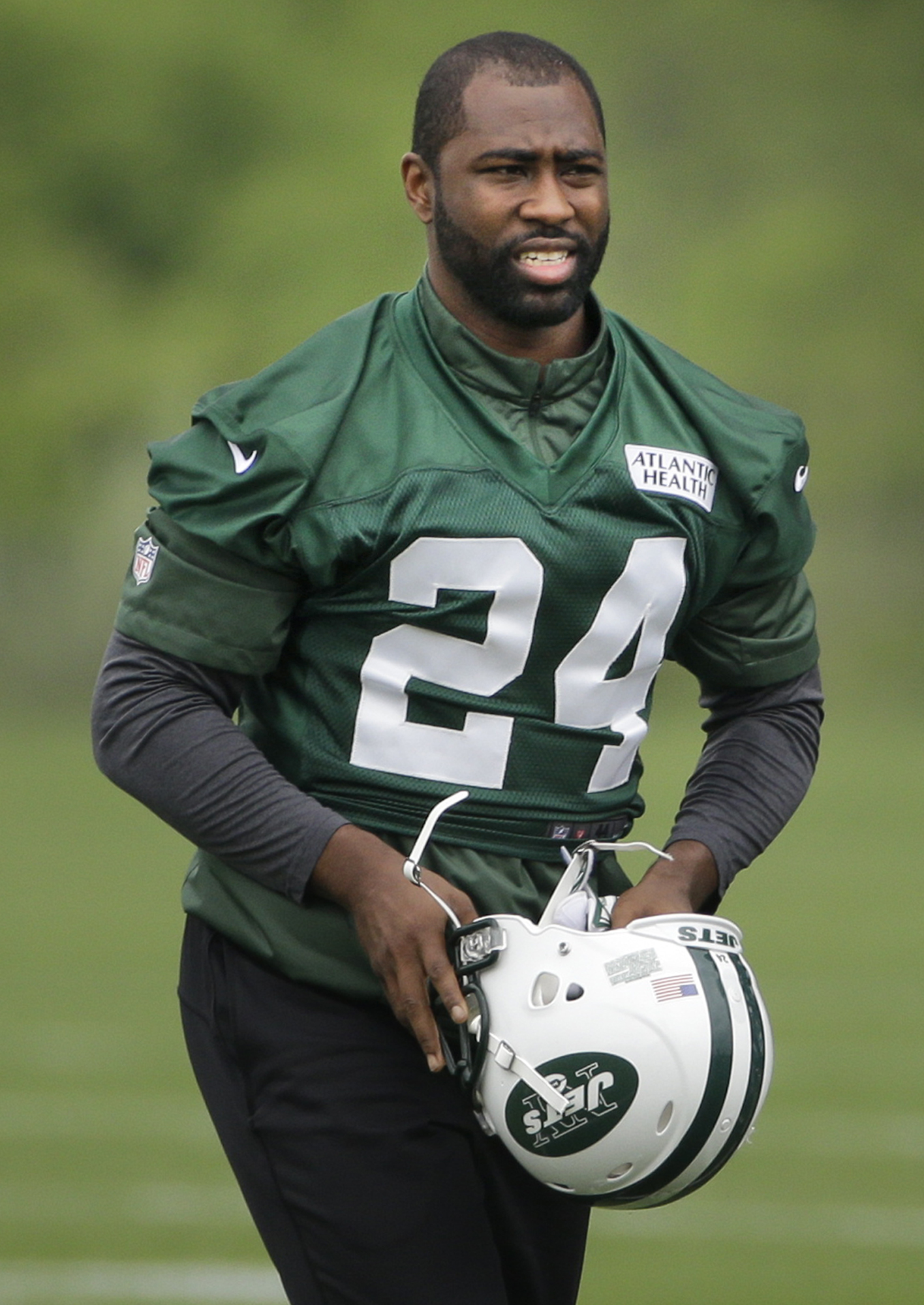 FILE - In this May 27, 2015, file photo, New York Jets' Darrelle Revis gets ready for an NFL football organized team activity in Florham Park, N.J. After the Jets struggled with an injury-filled and inconsistent secondary, they brought back free-agent cor