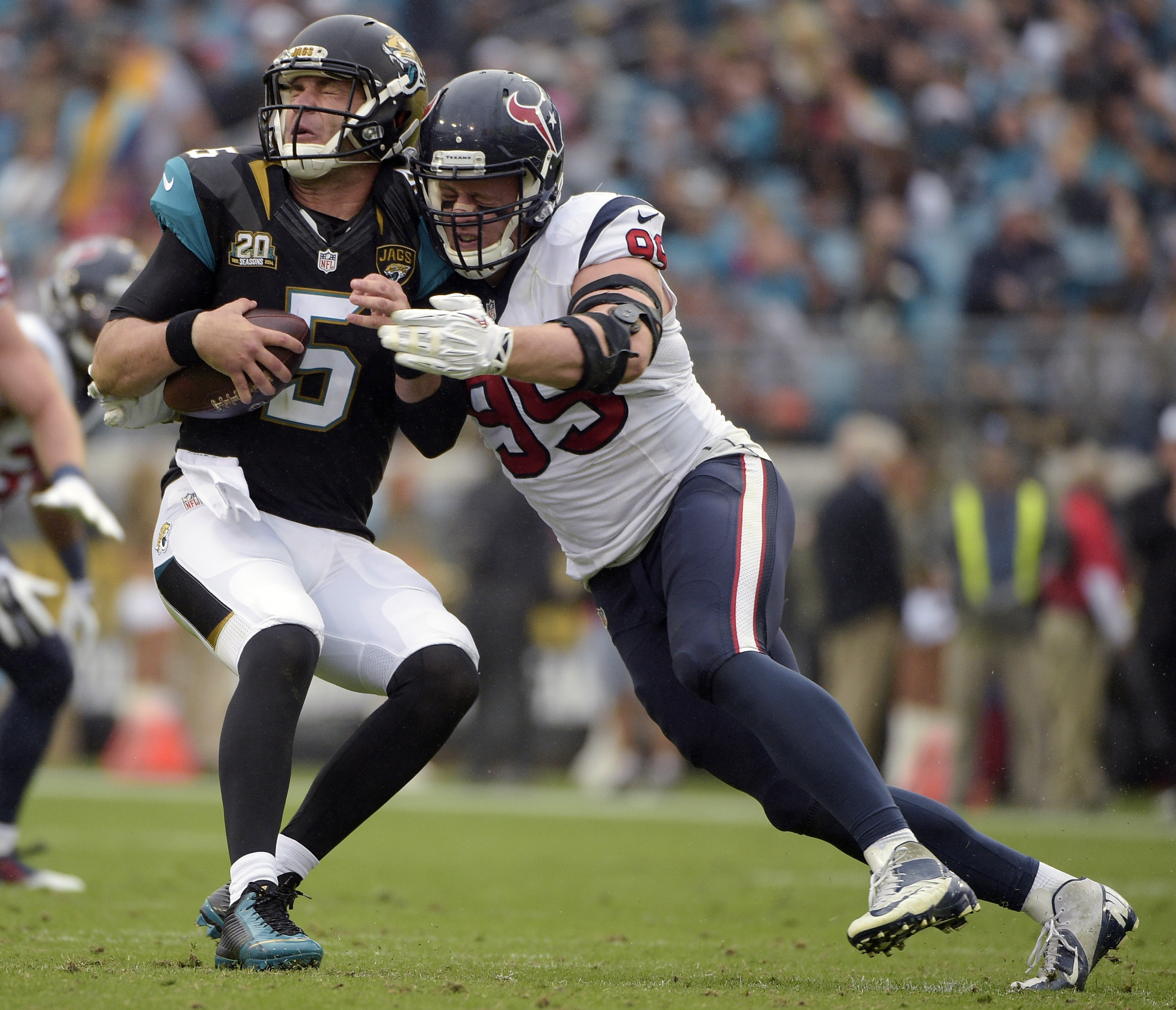 FILE - In this Dec. 7, 2014, file photo, Jacksonville Jaguars quarterback Blake Bortles (5) is sacked by Houston Texans defensive end J.J. Watt (99) during the first half of an NFL football game in Jacksonville, Fla. Watt is coming off a spectacular seaso