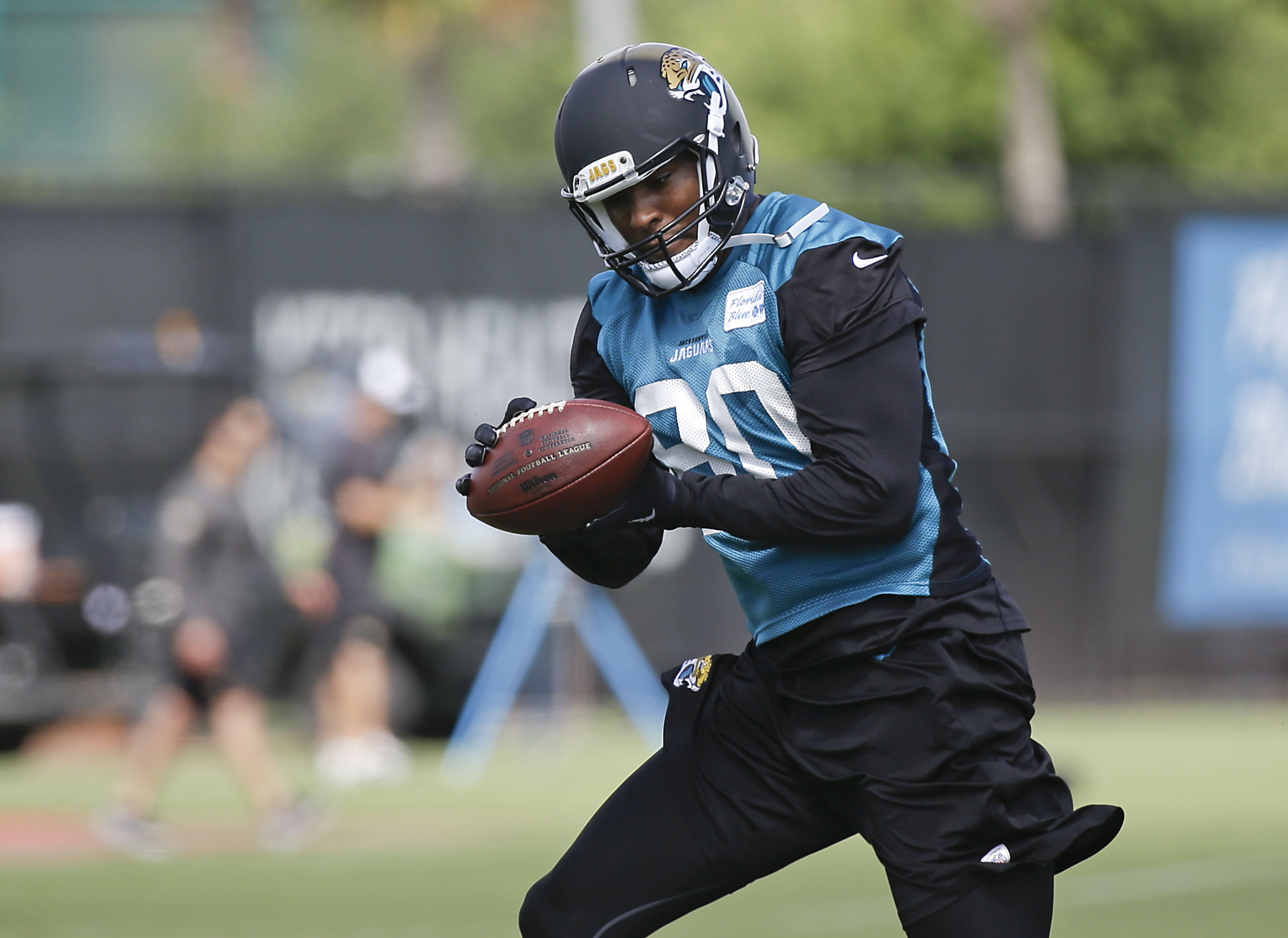 FILE - In this Wednesday, May 27, 2015, file photo, Jacksonville Jaguars receiver Julius Thomas catches a pass during NFL football organized training activities in Jacksonville, Fla. Jacksonville was one of the most active teams in free agency, landing ti