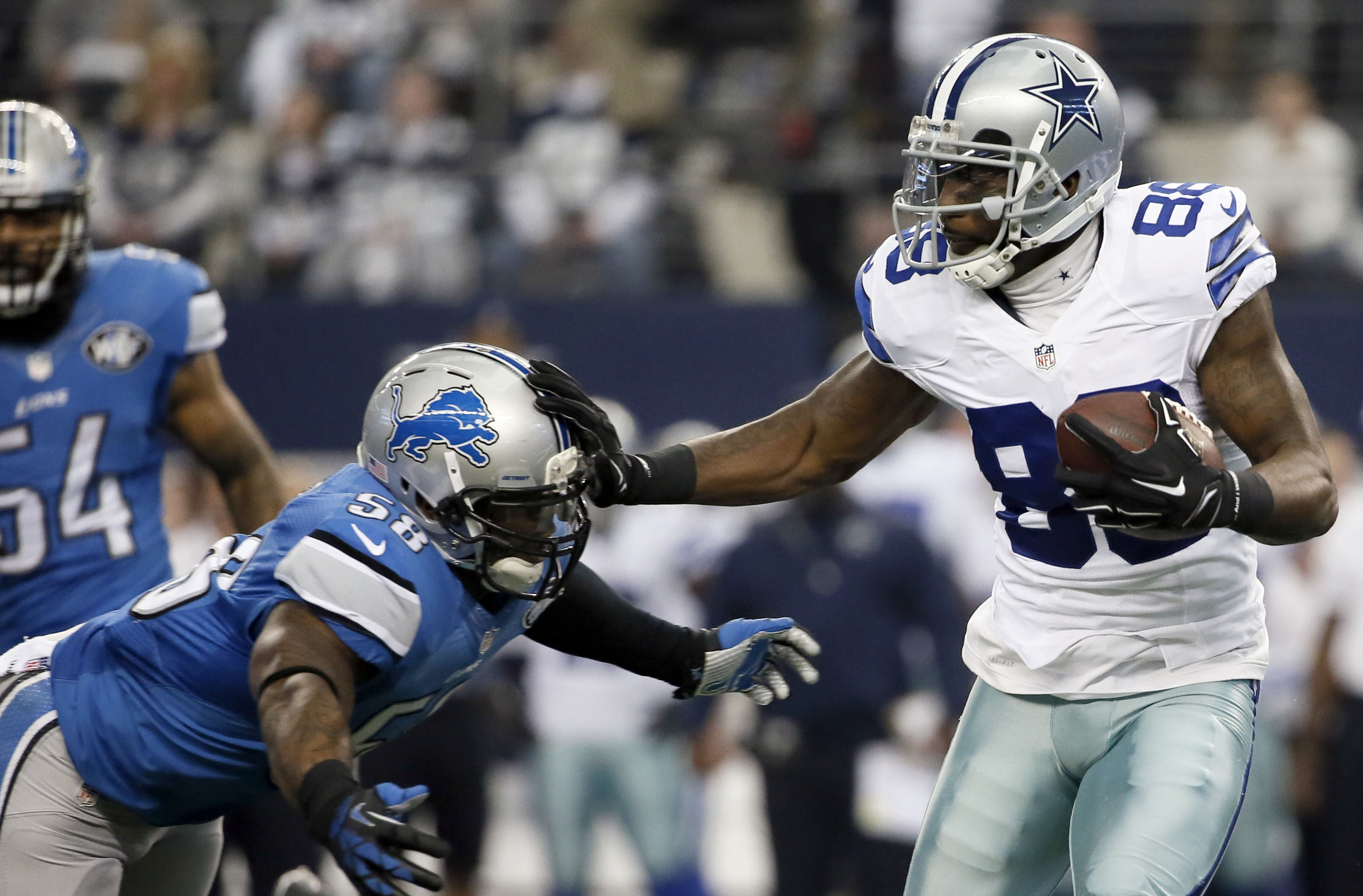 FILE - In this Sunday, Jan. 4, 2015, file photo, Dallas Cowboys wide receiver Dez Bryant (88) carries the ball against Detroit Lions outside linebacker Ashlee Palmer (58) during the first half of an NFL wildcard playoff football game in Arlington, Texas.