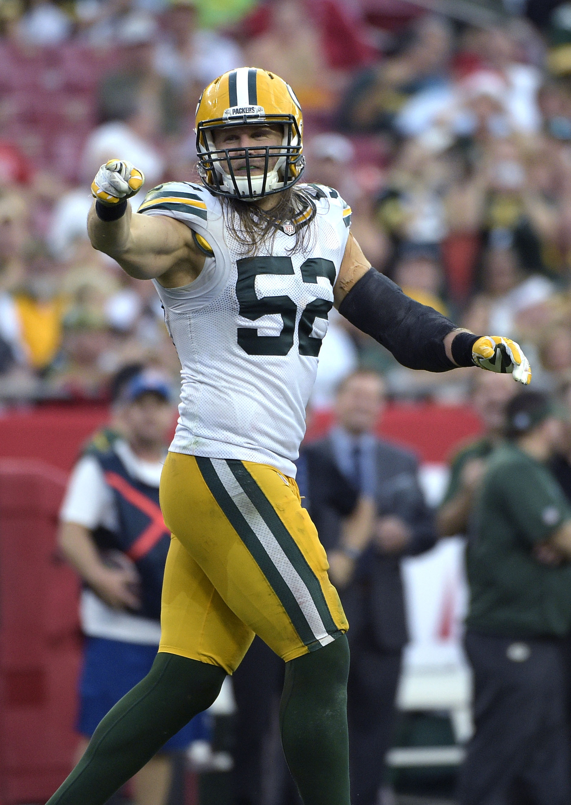 FILE - In this  Sunday, Dec. 21, 2014 file photo, Green Bay Packers outside linebacker Clay Matthews (52) celebrates after sacking Tampa Bay Buccaneers quarterback Josh McCown during the second half of an NFL football game in Tampa, Fla. (AP Photo/Phelan