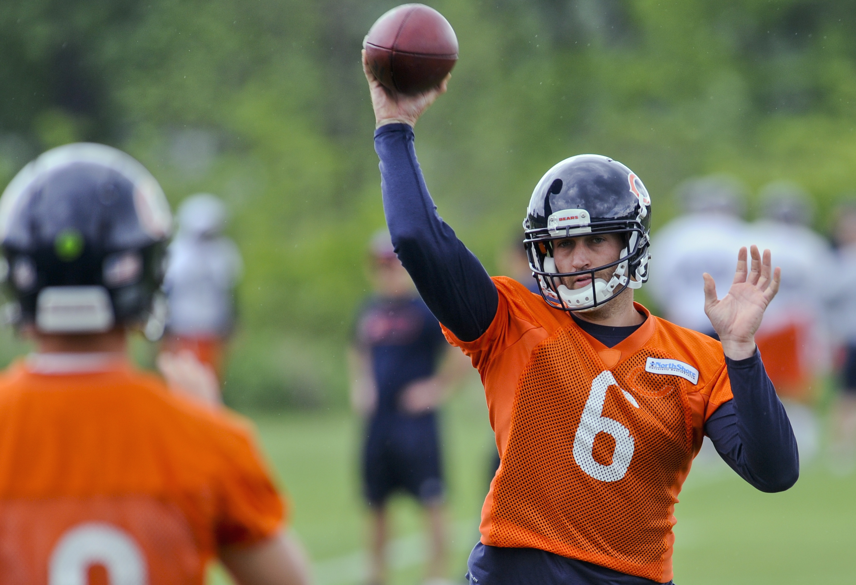 FILE - In this May 27, 2015, file photo, Chicago Bears quarterback Jay Cutler throws a pass during an NFL football organized team activity in Lake Forest, Ill. Training camp opens July 29. (AP Photo/Matt Marton, File)