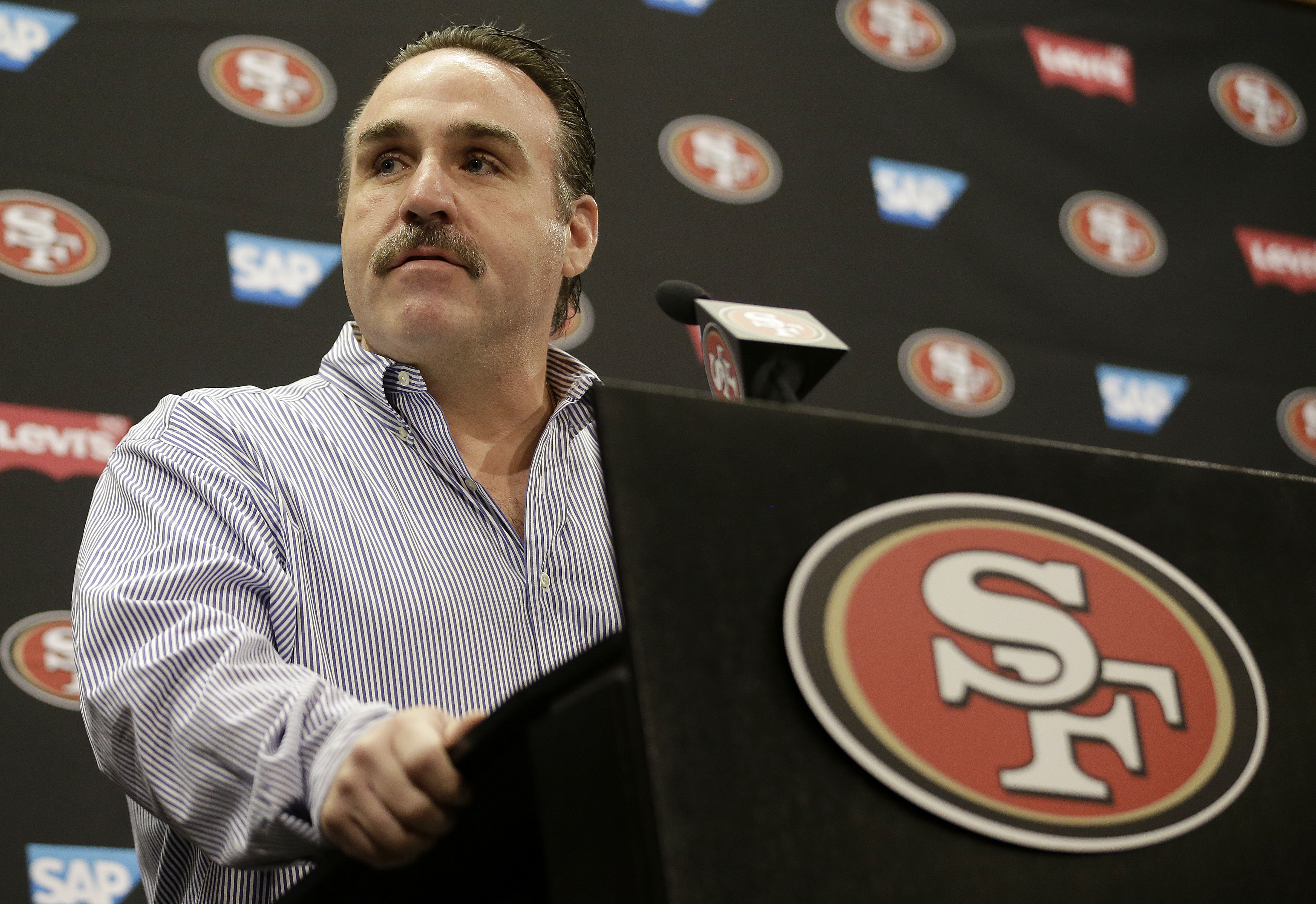 FILE - In this March 10, 2015, file photo, San Francisco 49ers head coach Jim Tomsula speaks during a news conference at the NFL football team's facility in Santa Clara, Calif. (AP Photo/Jeff Chiu, File)