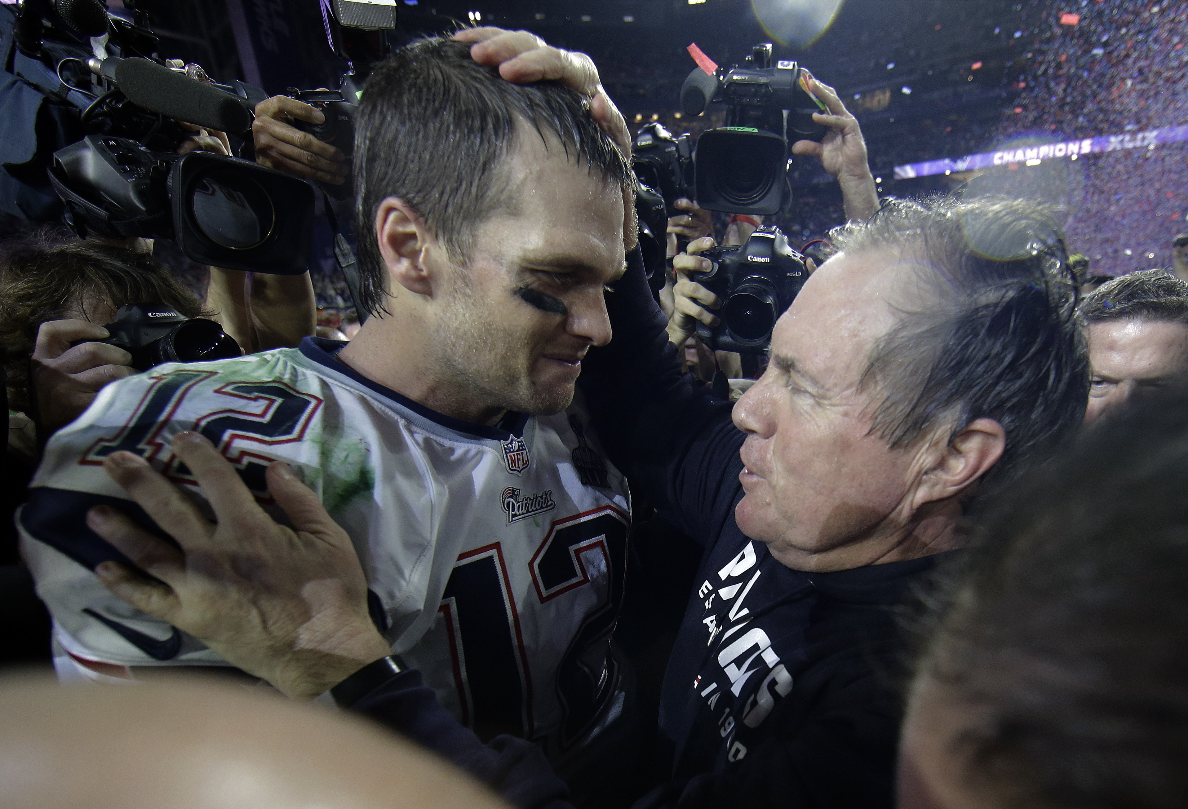 FILE - In this Feb. 1, 2015, file photo, New England Patriots quarterback Tom Brady celebrates with head coach Bill Belichick after winning NFL Super Bowl XLIX football game against the Seattle Seahawks  in Glendale, Ariz. The Patriots won 28-24. (AP Phot
