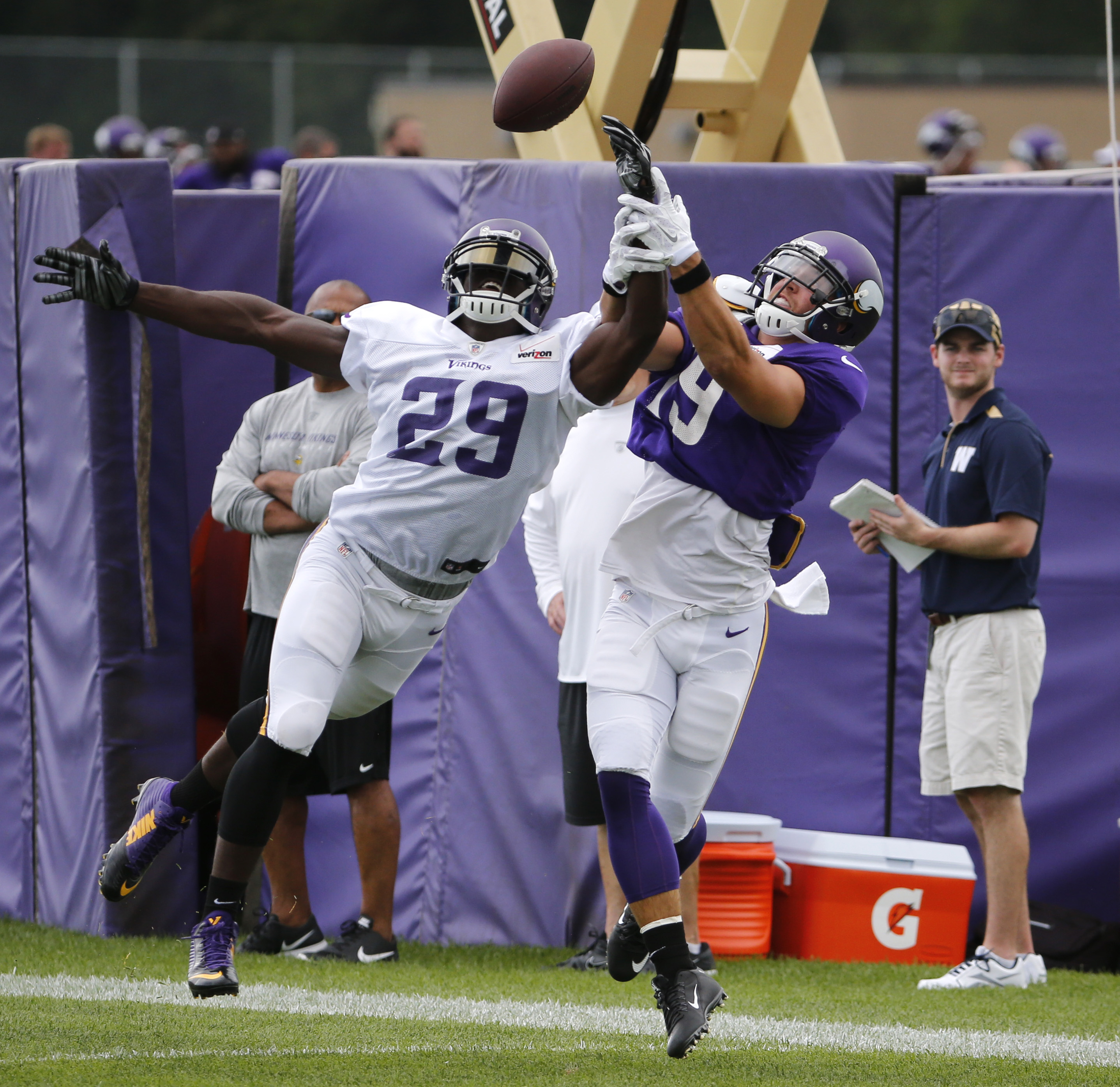 Minnesota Vikings cornerback Xavier Rhodes (29) breaks up a pass intended for wide receiver Adam Thielen during the first practice in full pads at an NFL football training camp on the campus of Minnesota State University Tuesday, July 28, 2015, in Mankato