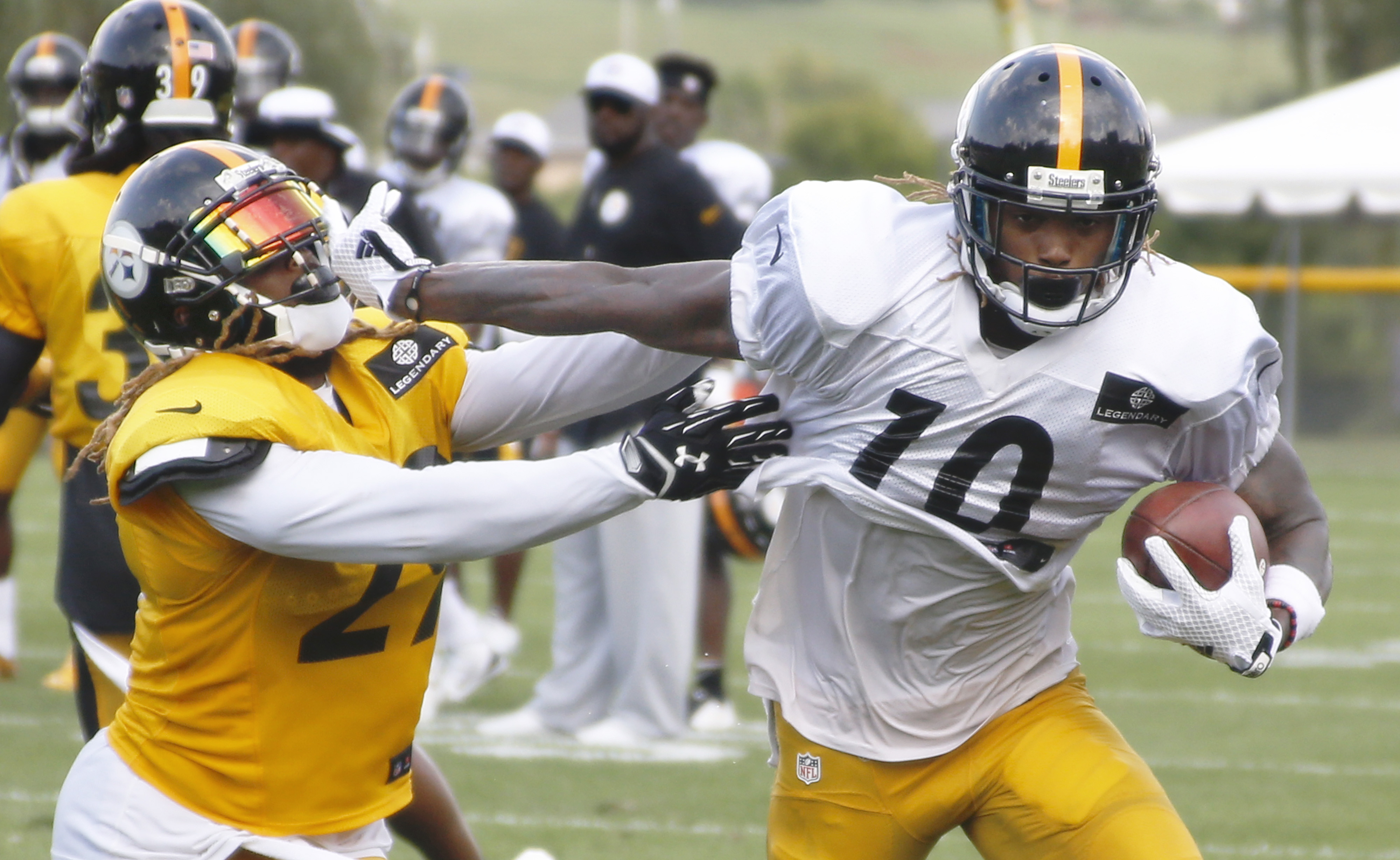 Pittsburgh Steelers wide receiver Martavis Bryant (10), right,  breaks away from strong safety Shamarko Thomas (29) after catching a pass at practice during NFL football training camp in Latrobe, Pa., Wednesday, July 29, 2015. (AP Photo/Keith Srakocic)