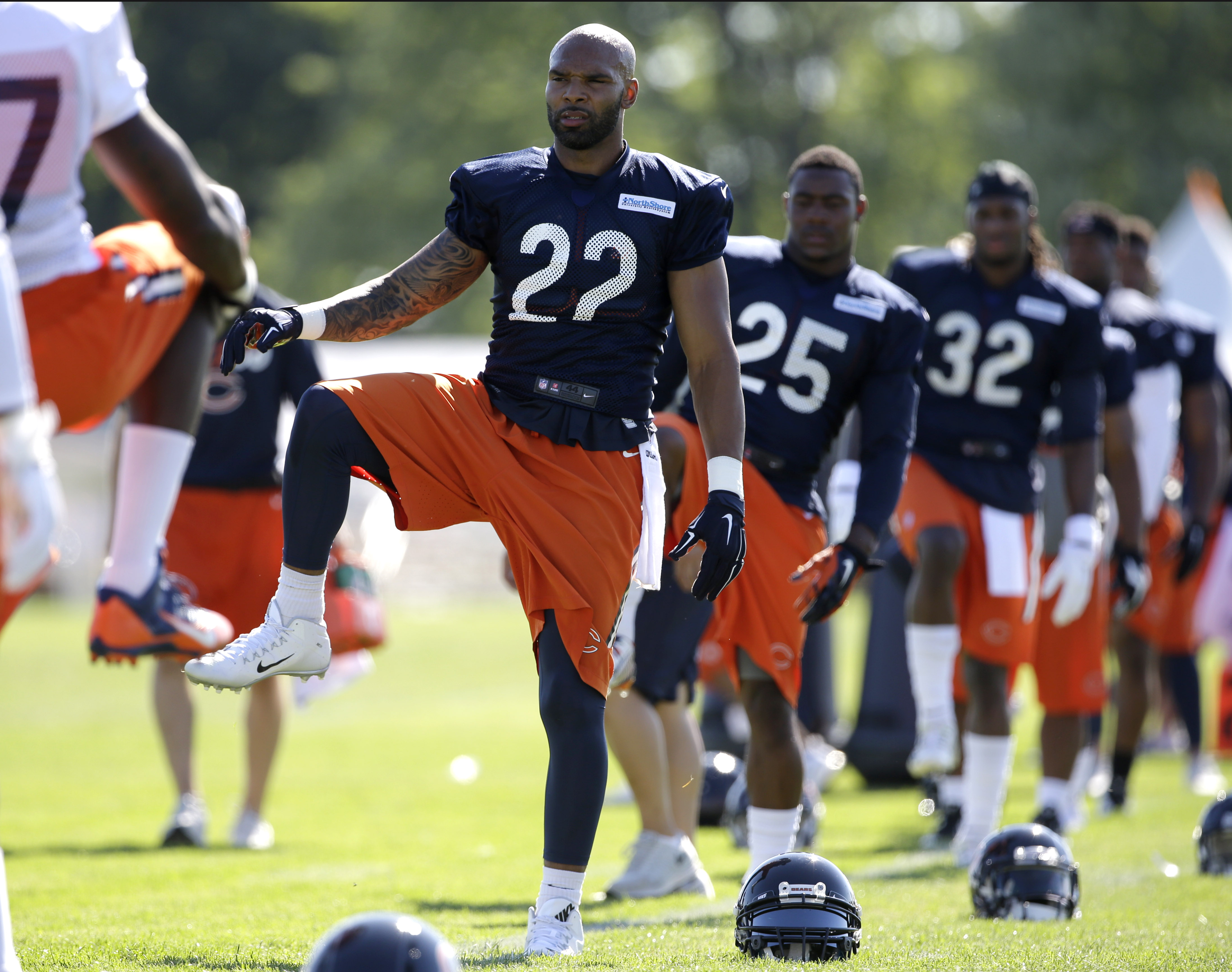Chicago Bears runningback Matte Forte (22) stretches with teammates during an NFL football training camp at Olivet Nazarene University, Thursday, July 30, 2015, in Bourbonnais, Ill. (AP Photo/Nam Y. Huh)