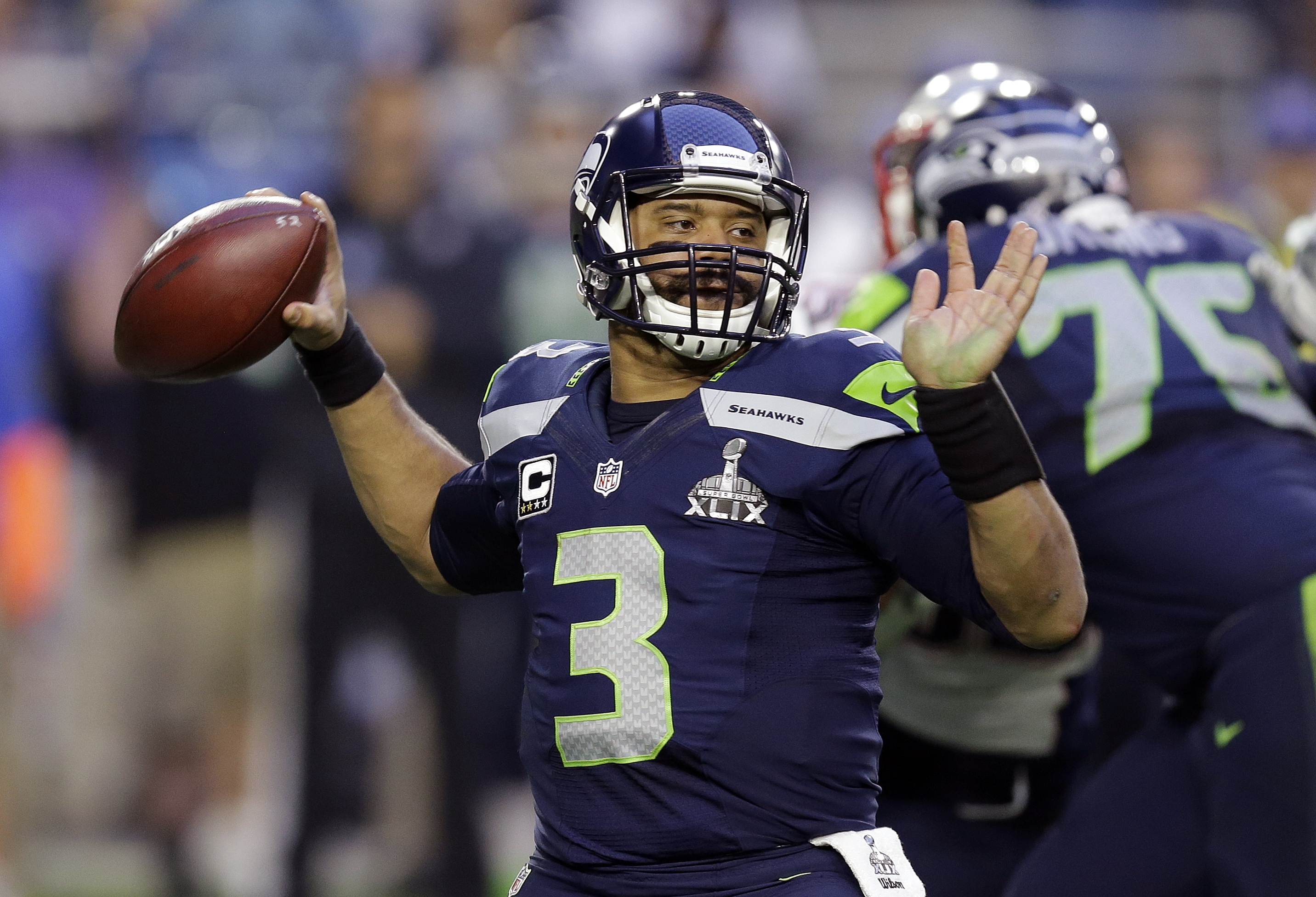 FILE - In this Feb. 1, 2015, file photo, Seattle Seahawks quarterback Russell Wilson (3) throws a pass during the first half of NFL Super Bowl XLIX football game against the New England Patriots in Glendale, Ariz. Wilson tweeted Friday morning, July 31, 2