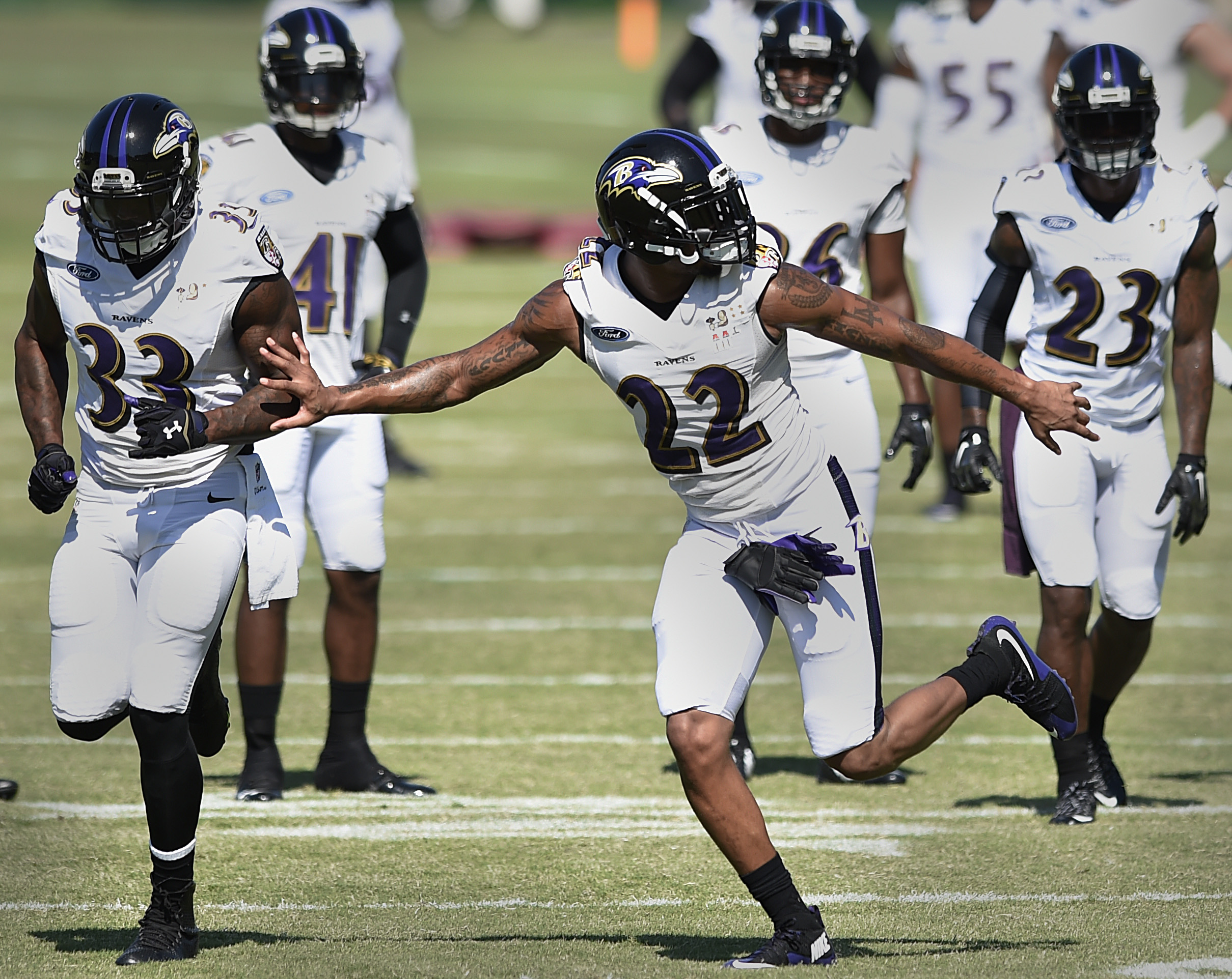 Baltimore Ravens corner back Jimmy Smith (22), runs a drill during NFL football training camp, Friday, July 31, 2015, in Owings Mills, Md. (AP Photo/Gail Burton)