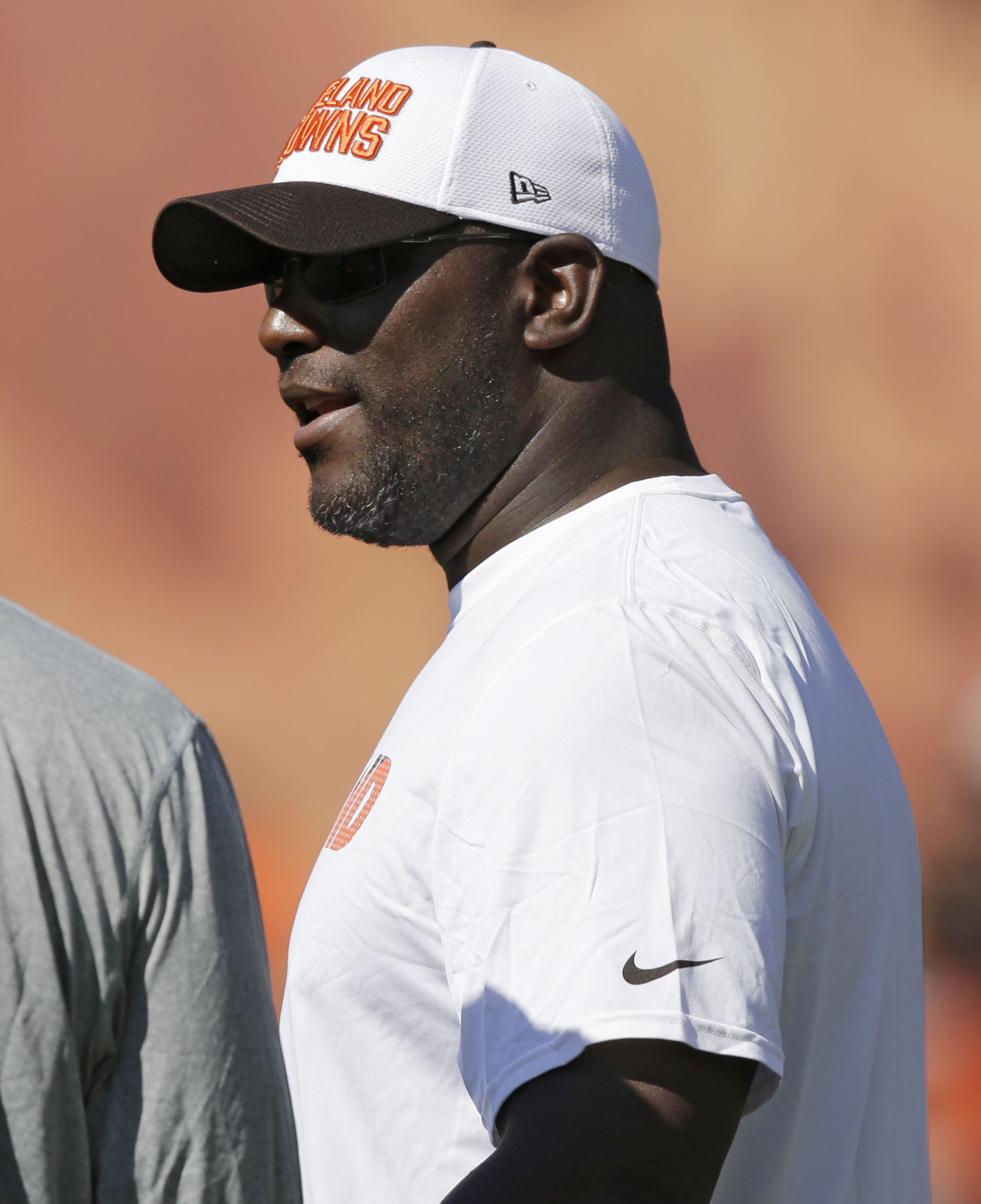 Cleveland Browns general manager Ray Farmer watches practice at the NFL football team's training camp Friday, July 31, 2015, in Berea, Ohio. (AP Photo/Tony Dejak)