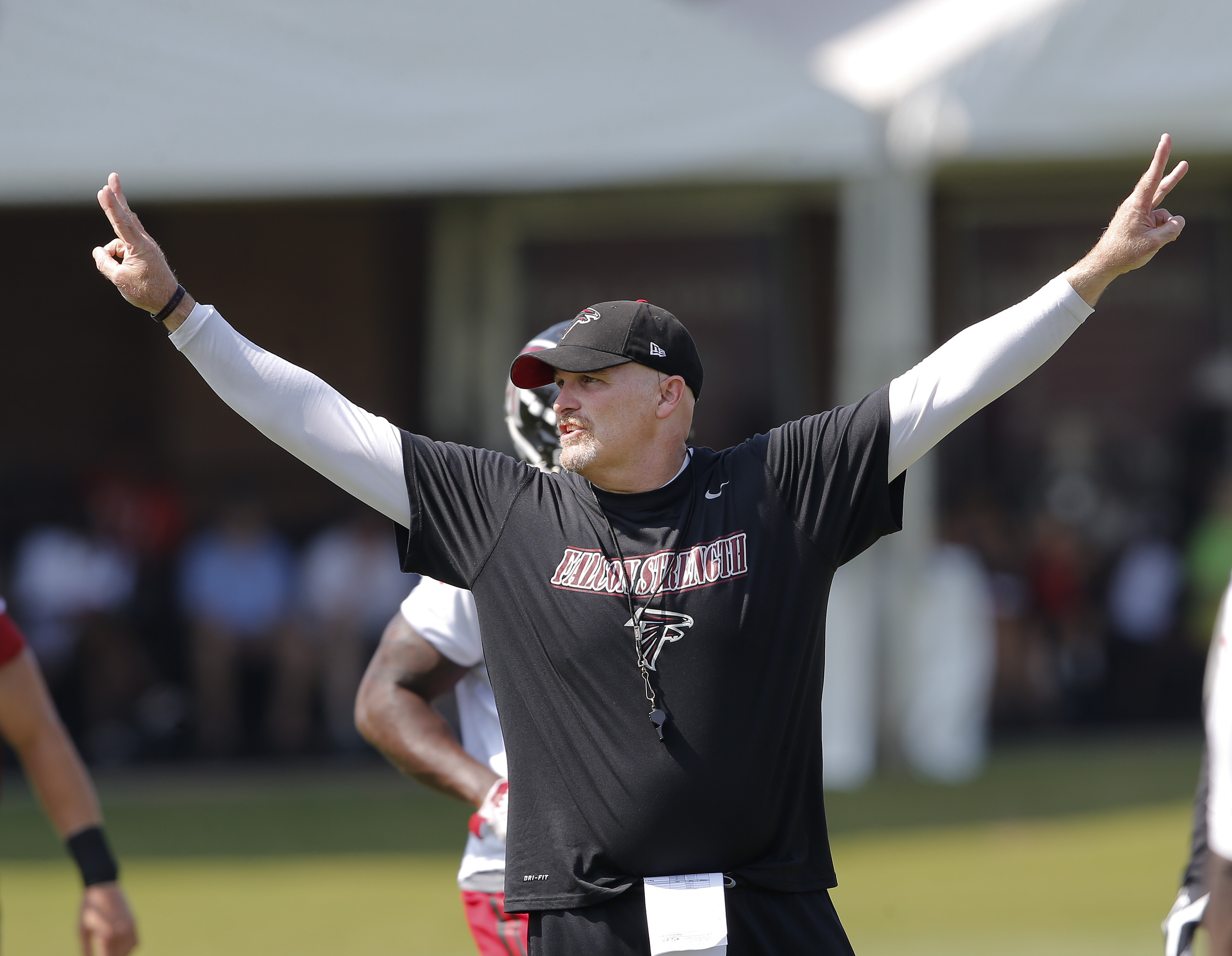Atlanta Falcons head coach Dan Quinn directs his players during an NFL football training camp  Friday, July 31, 2015, in Flowery Branch, Ga. (AP Photo/John Bazemore)