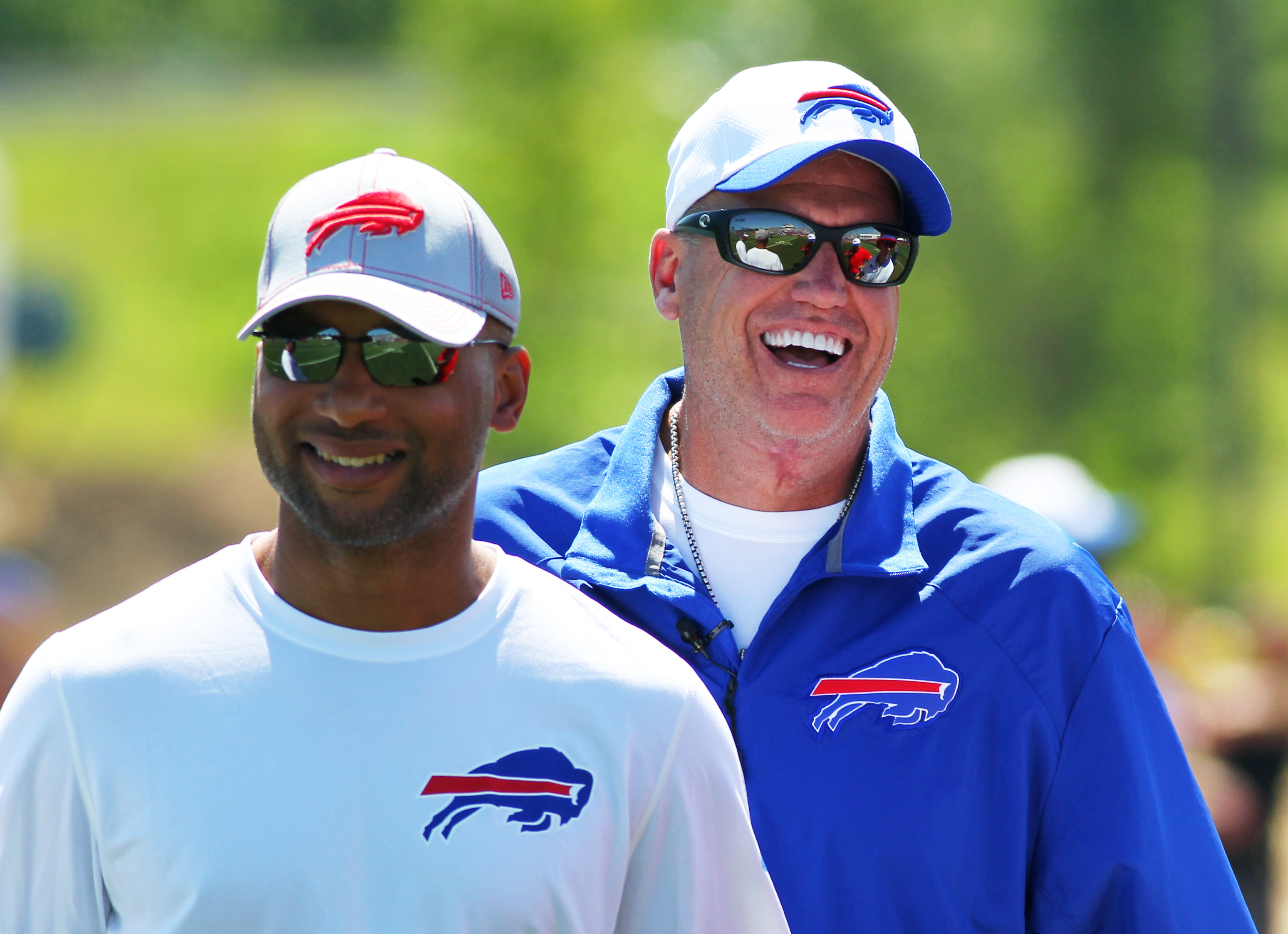 Buffalo Bills general manager Doug Whaley, left, and head coach Rex Ryan share a laugh during their team's NFL football training camp in Pittsford, N.Y., Friday, July 31, 2015. (AP Photo/Bill Wippert)