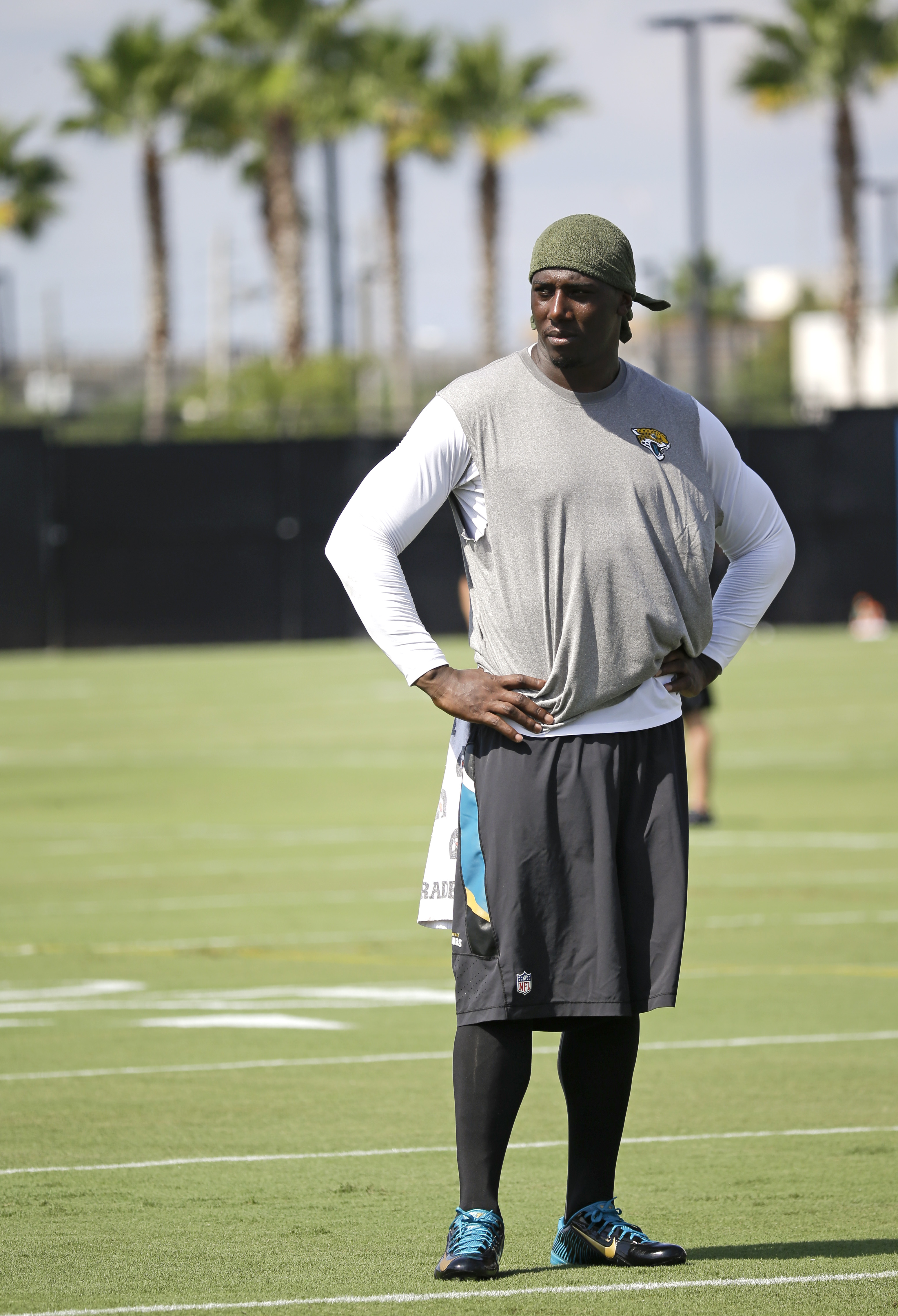 Jacksonville Jaguars defensive end Chris Clemons watches teammates during practice at NFL football training camp, Friday, July 31, 2015, in Jacksonville, Fla. Clemons arrived a day late for camp and did not practice Friday.(AP Photo/John Raoux)