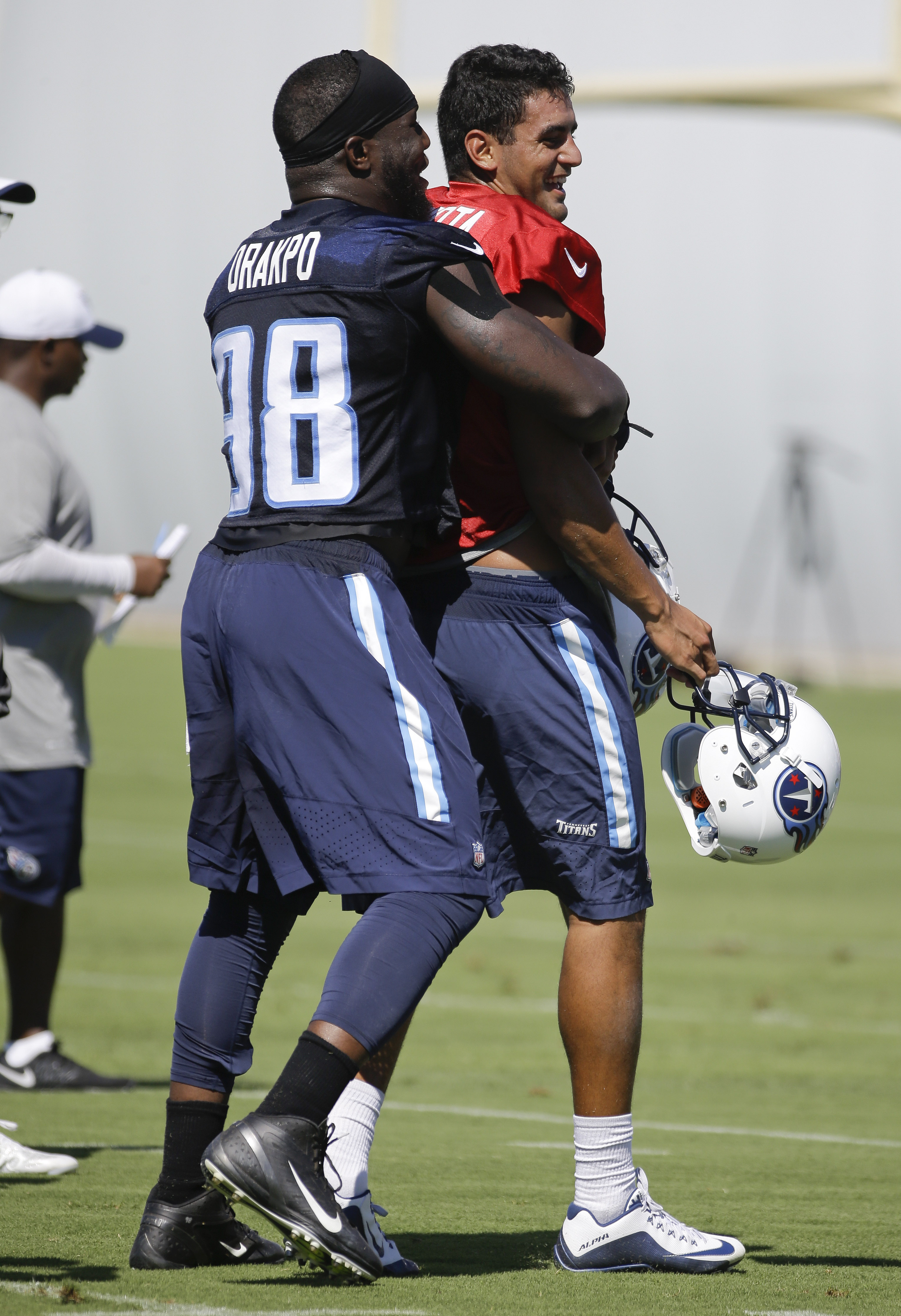Tennessee Titans linebacker Brian Orakpo (98) hugs quarterback Marcus Mariota, right, during the first day of NFL football training camp Friday, July 31, 2015, in Nashville, Tenn. (AP Photo/Mark Humphrey)