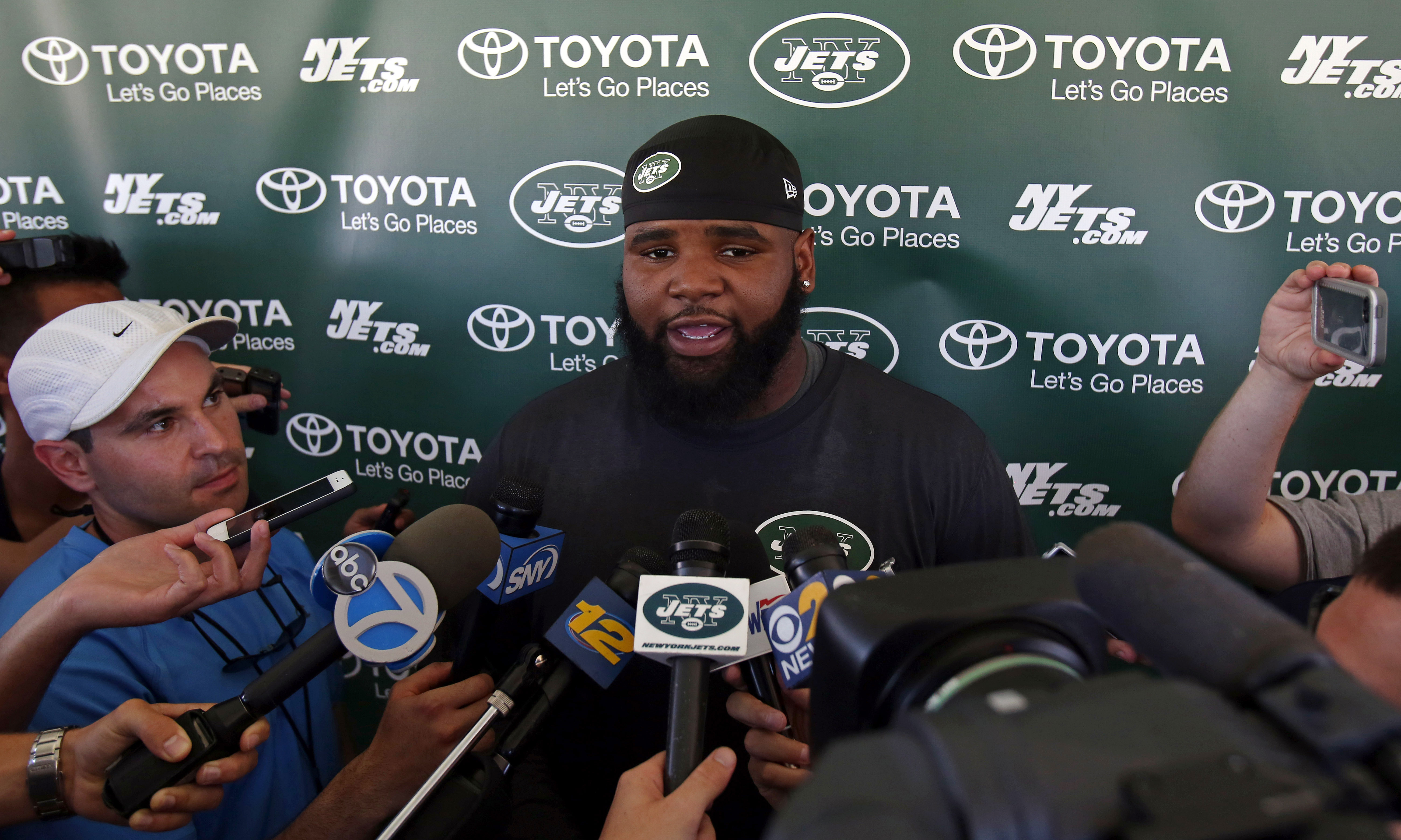 New York Jets defensive end Sheldon Richardson talks with reporters at NFL football training camp in Florham Park, N.J., Friday, July 31, 2015. (AP Photo/Adam Hunger)