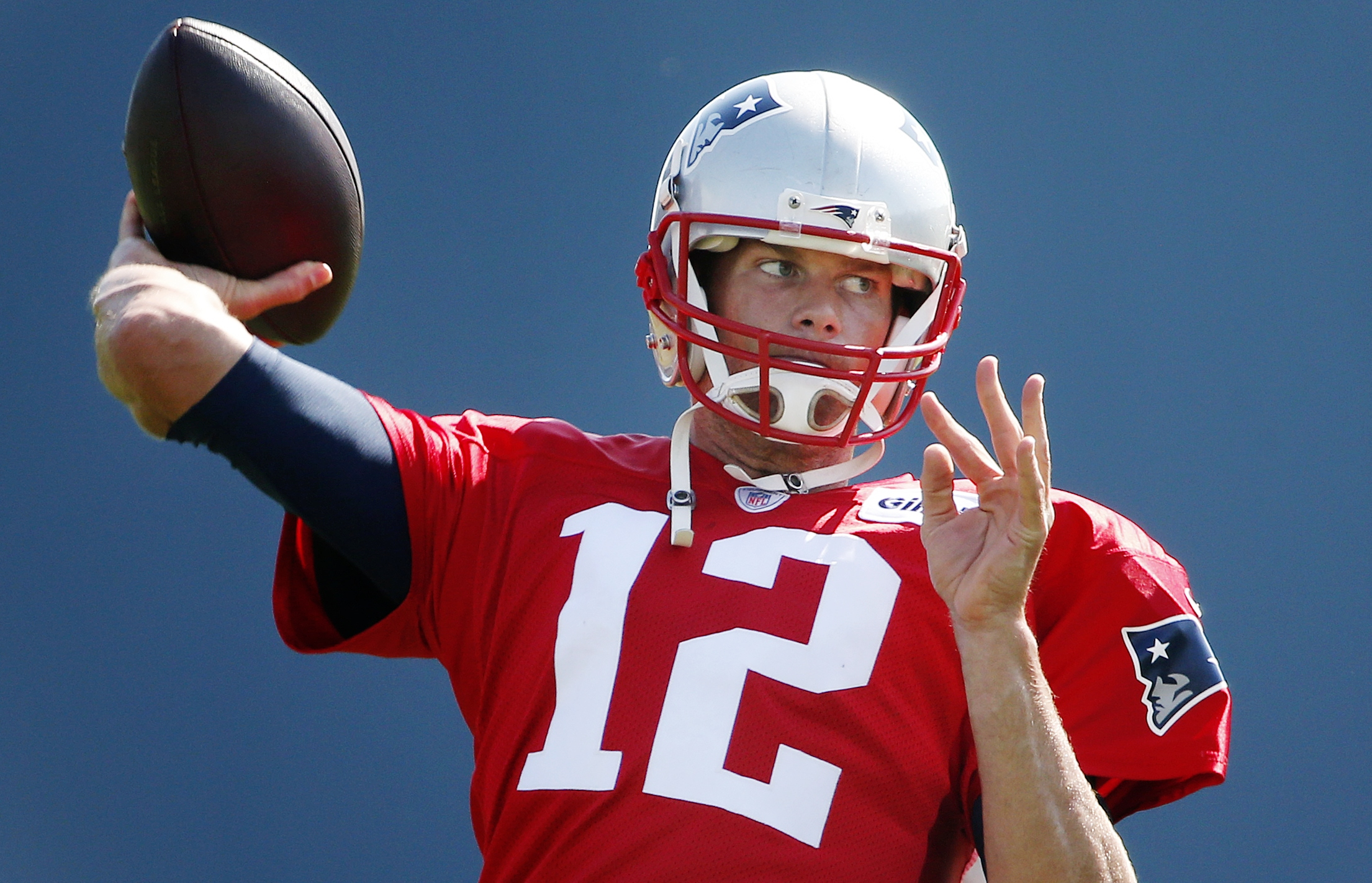 New England Patriots quarterback Tom Brady passes during an NFL football training camp in Foxborough, Mass., Saturday, Aug. 1, 2015. (AP Photo/Michael Dwyer)
