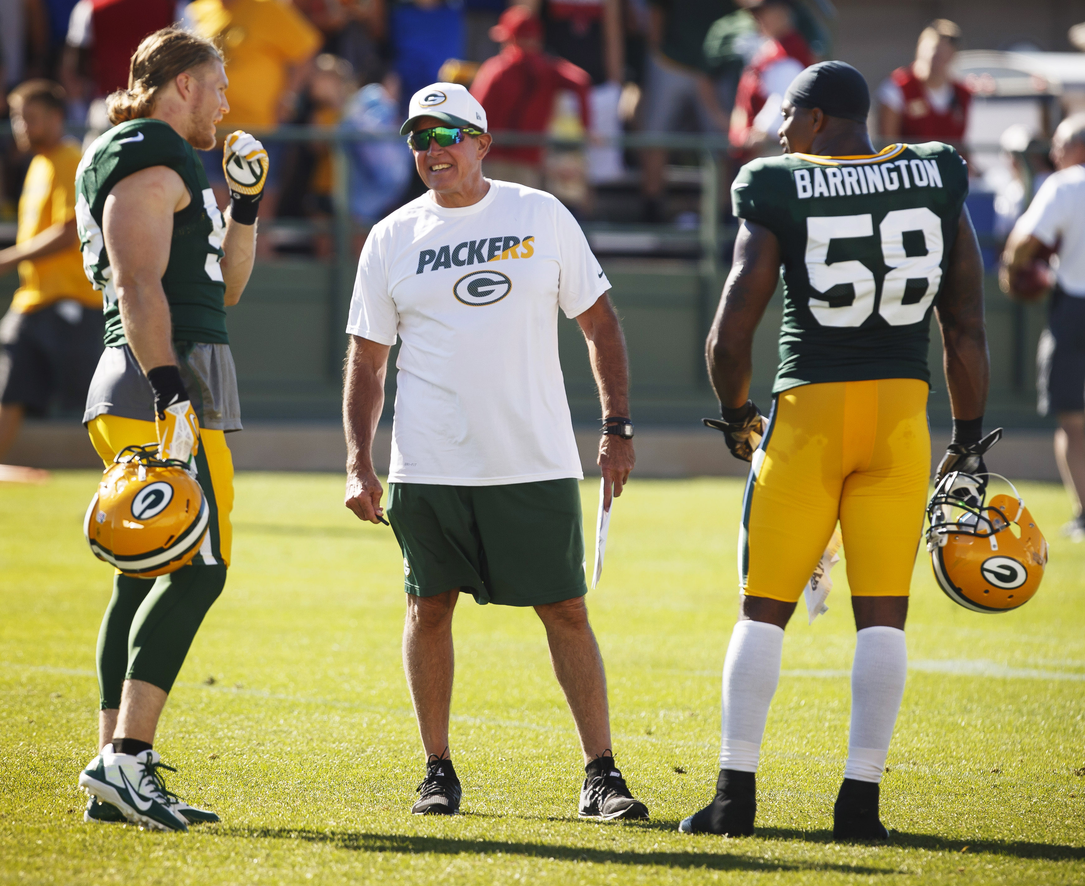 Green Bay Packers defensive coordinator Dom Capers talks with Clay Matthews, left, and Sam Barrington during NFL football training camp, Saturday, Aug. 1 , 2015, in Green Bay, Wis. (AP Photo/Mike Roemer)