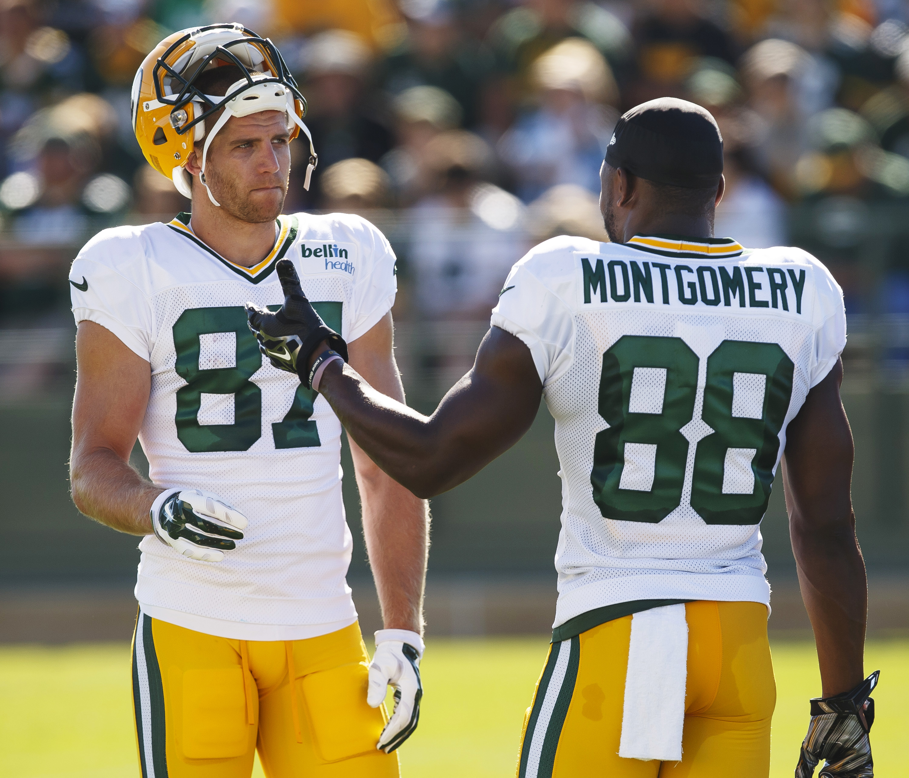 Green Bay Packers' Jordy Nelson, left,  and Ty Montgomery talk during NFL football training camp, Saturday, Aug. 1 , 2015, in Green Bay, Wis. (AP Photo/Mike Roemer)