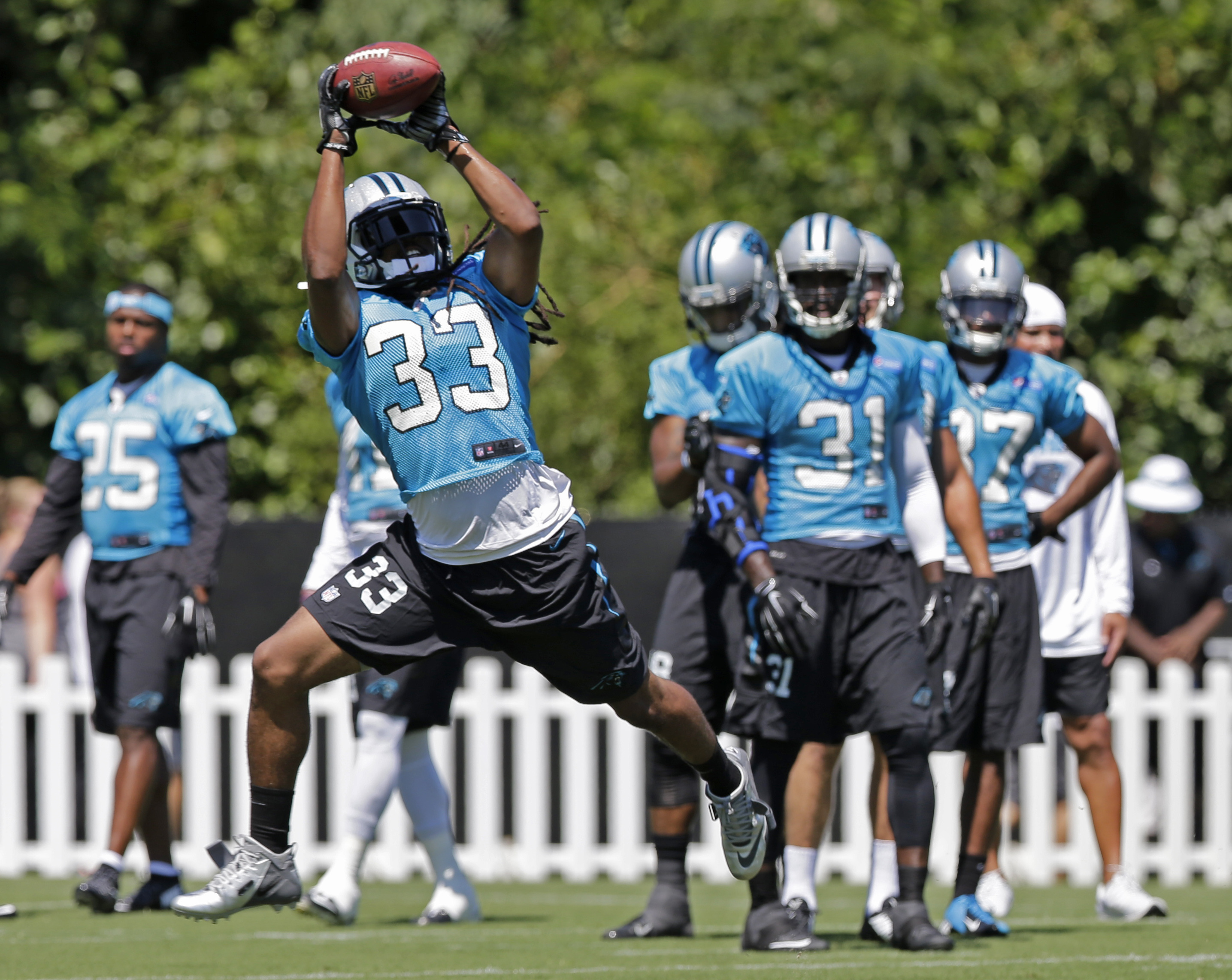 Carolina Panthers' Tre Boston (33) catches a ball in a drill during the NFL football team's training camp in Spartanburg, S.C., Saturday, Aug. 1, 2015. (AP Photo/Chuck Burton)