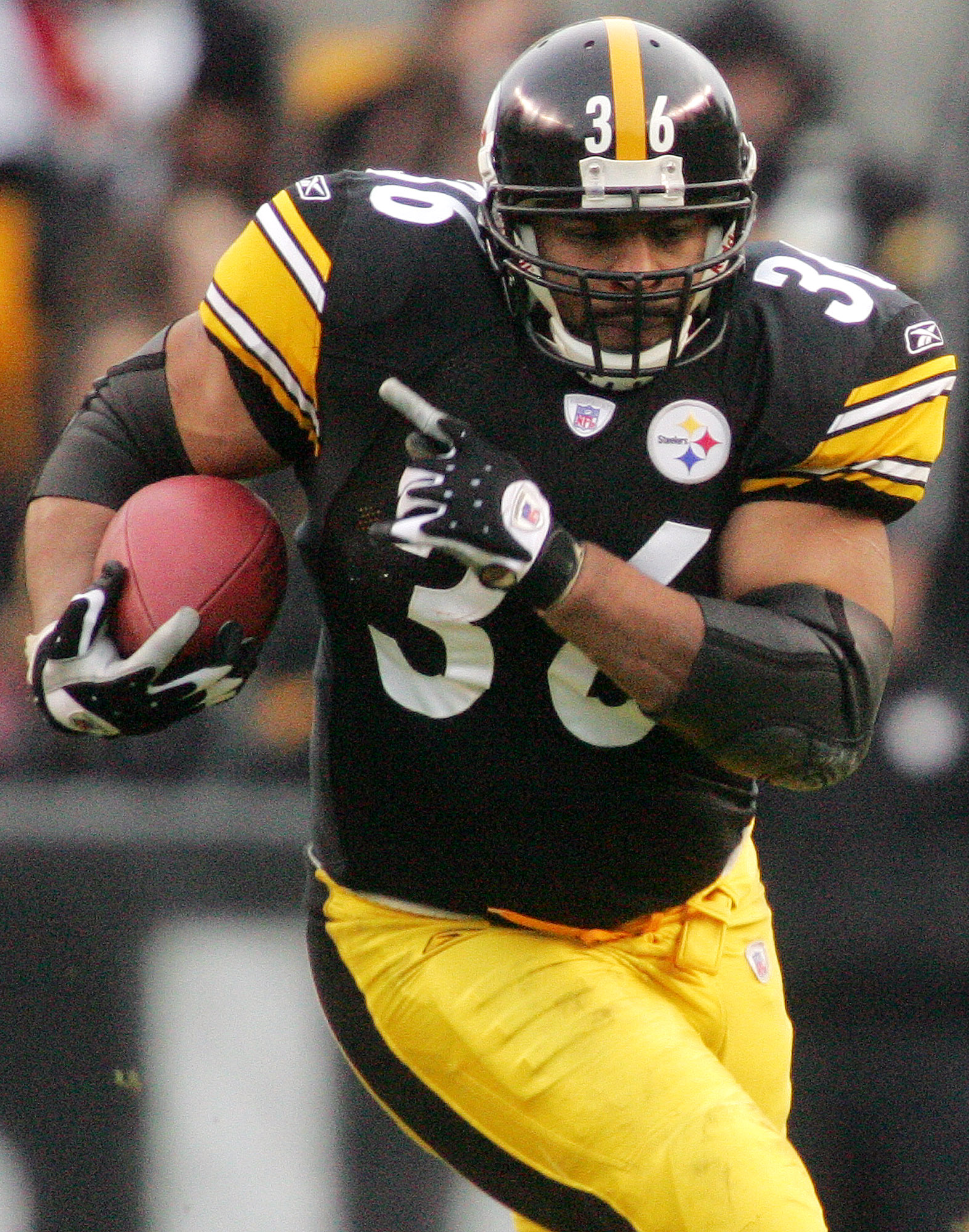 FILE - In this Jan. 1, 2006, file photo, Pittsburgh Steelers running back Jerome  Bettis carries the ball for 12 yards and a first down against the Detroit Lions in an NFL football game in Pittsburgh. Bettis waited five years to be elected to the Pro Foot