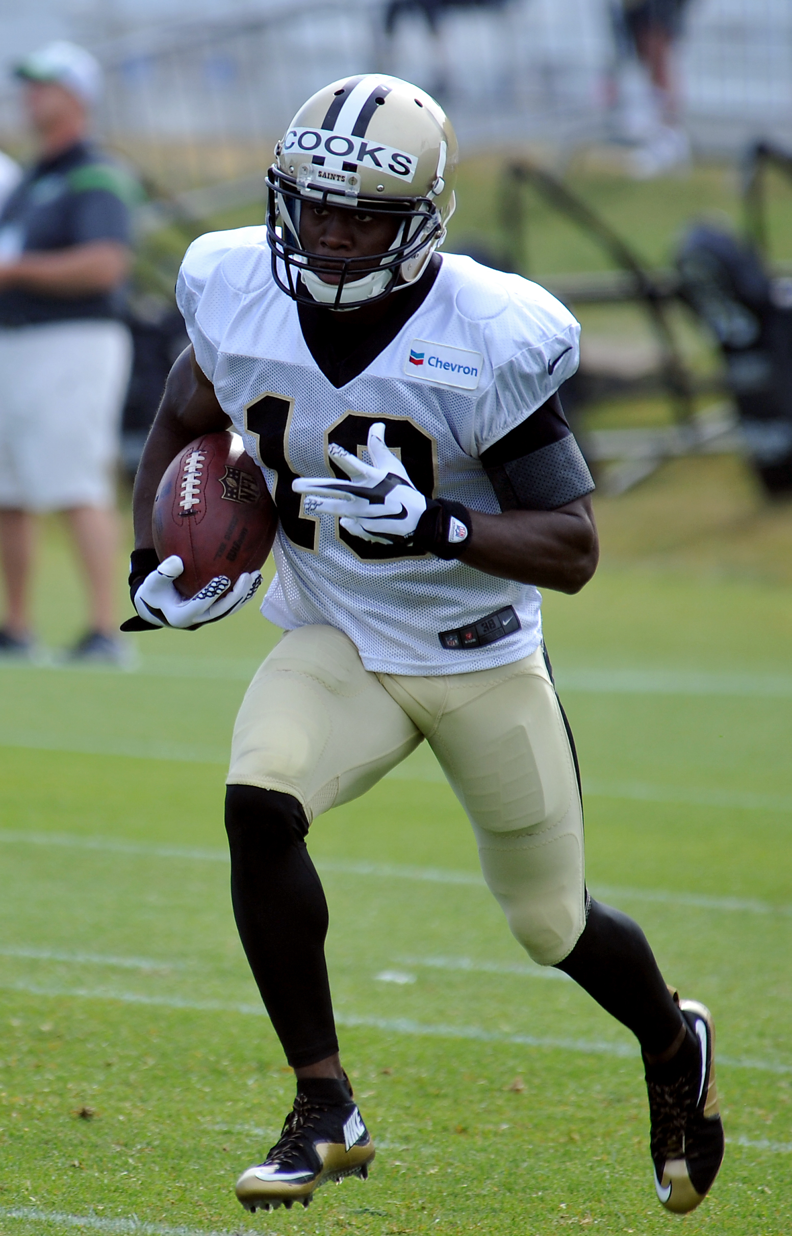 New Orleans Saints wide receiver Brandin Cooks (10) runs the ball during the teams NFL football training camp in White Sulphur Springs, W. Va., Sunday, Aug. 2, 2015. (AP Photo/Chris Tilley)
