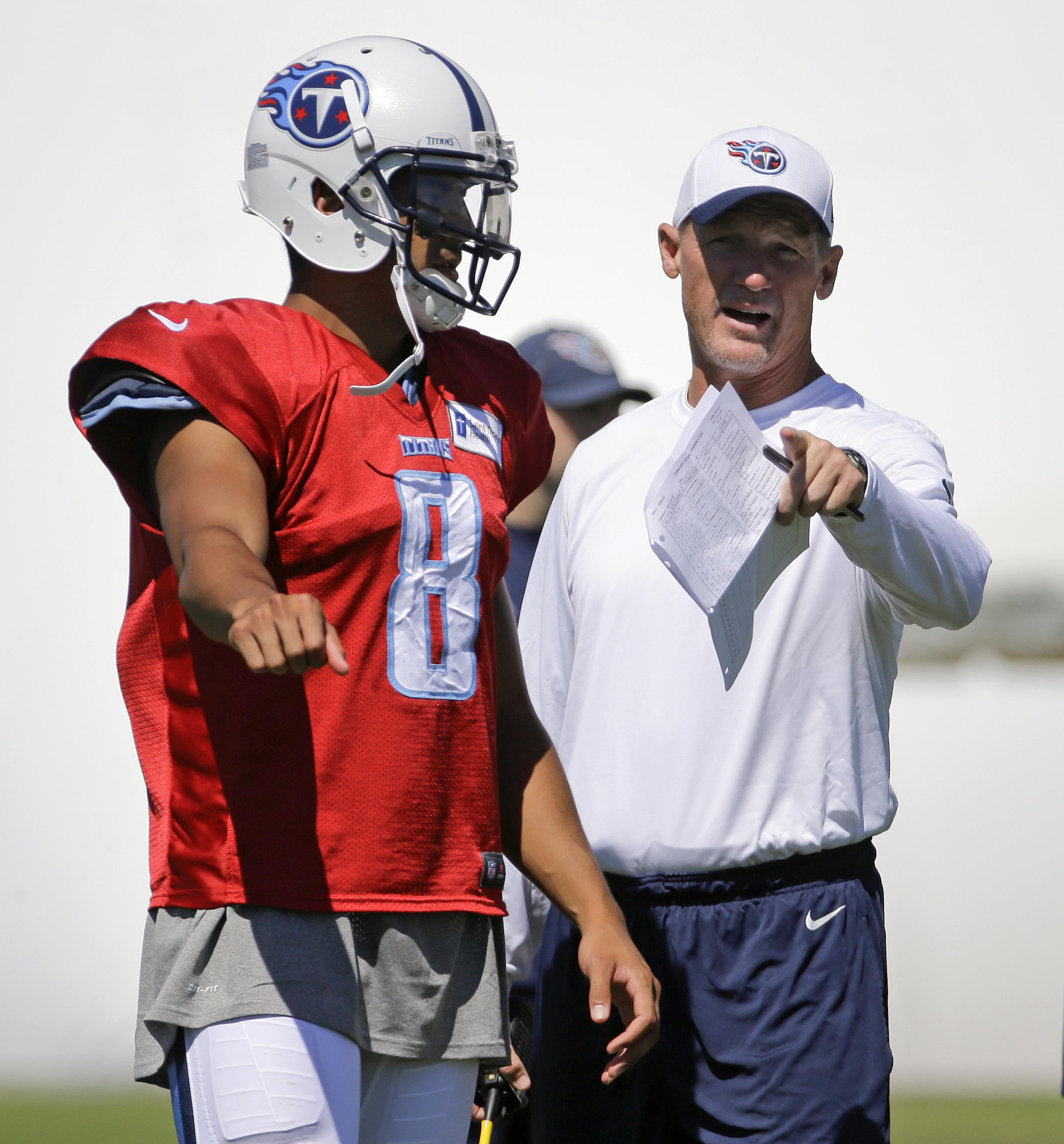 Tennessee Titans head coach Ken Whisenhunt, right, talks with quarterback Marcus Mariota (8) during NFL football training camp Sunday, Aug. 2, 2015, in Nashville, Tenn. (AP Photo/Mark Humphrey)