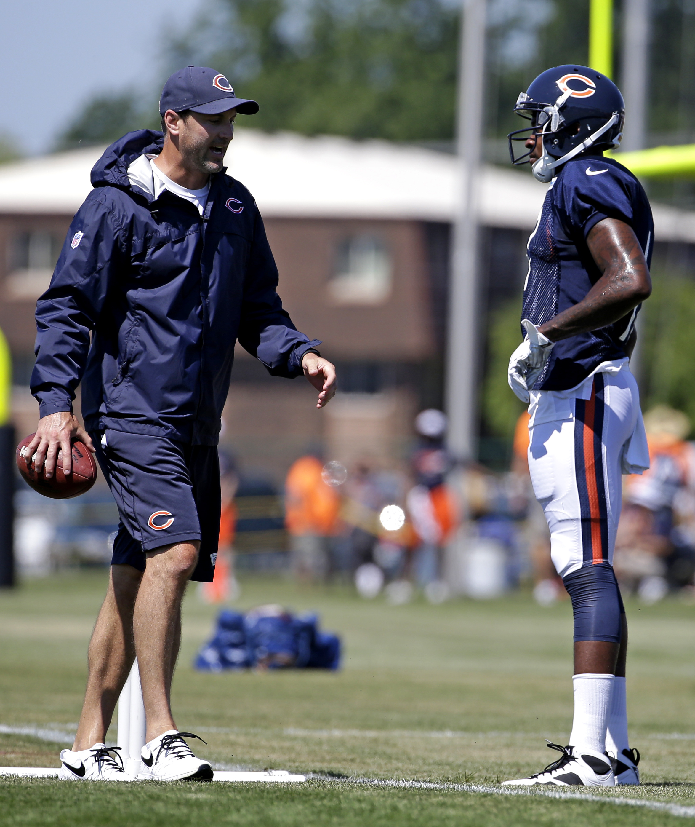 Chicago Bears wide receivers coach Mike Groh, left, talks with wide receiver Alshon Jeffery during NFL football training camp at Olivet Nazarene University, Sunday, Aug. 2, 2015, in Bourbonnais, Ill. (AP Photo/Nam Y. Huh)