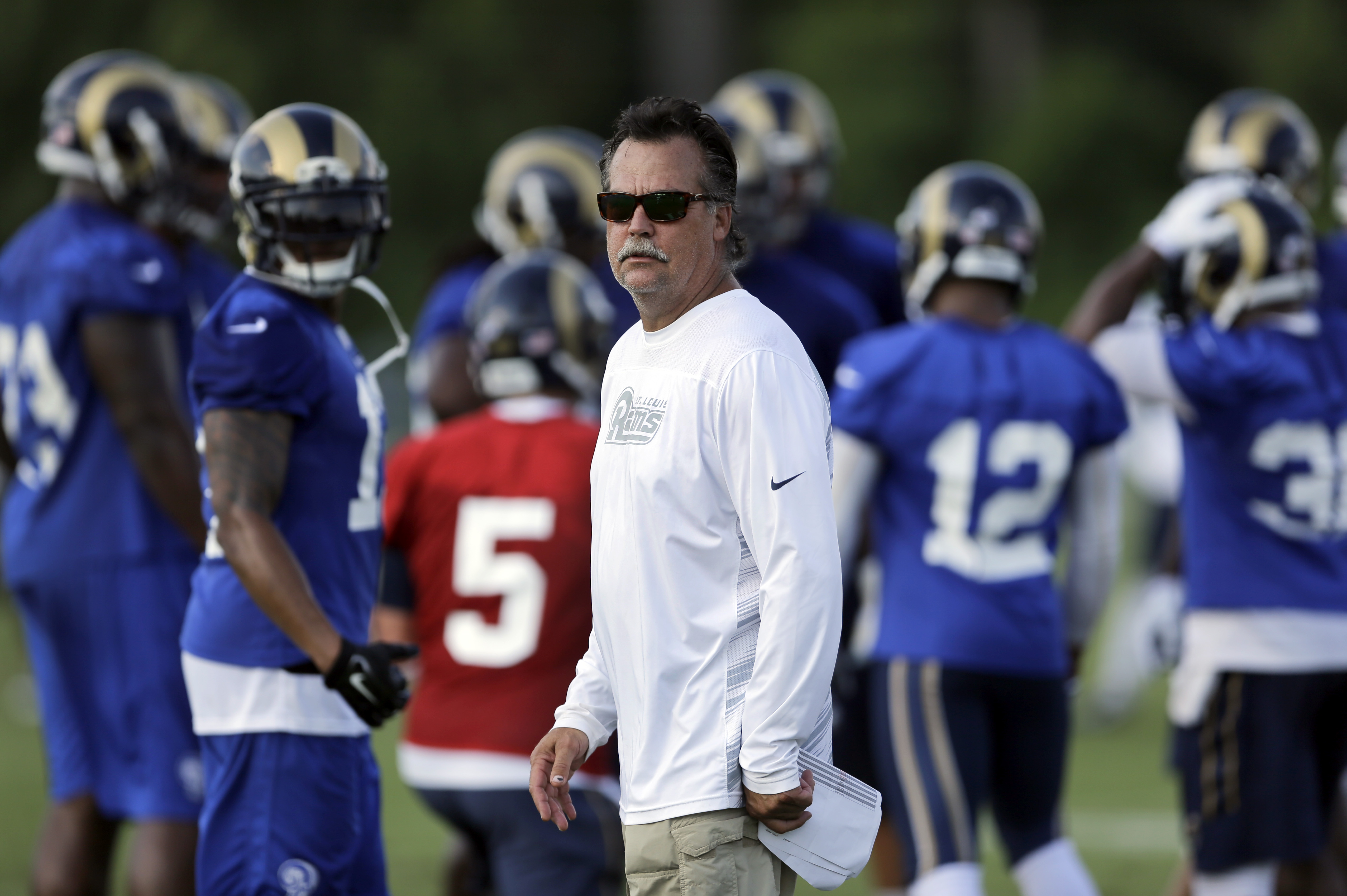 St. Louis Rams head coach Jeff Fisher watches his team during training camp at the NFL football team's practice facility, Sunday, Aug. 2, 2015, in St. Louis. (AP Photo/Jeff Roberson)