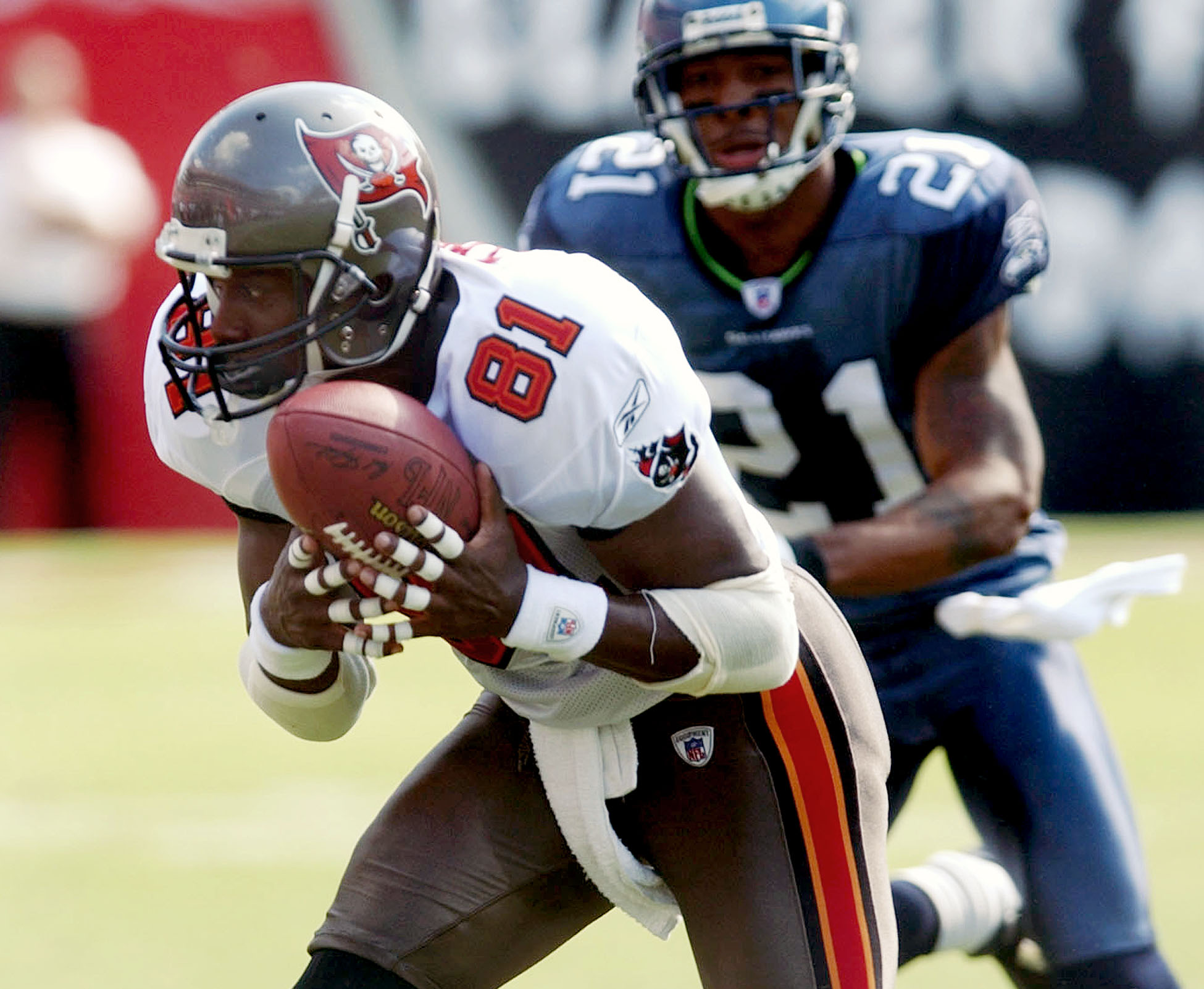 FILE - In this Sept. 19, 2004, file photo, Tampa Bay Buccaneers wide receiver Tim Brown (81) pulls in a pass in front of Seattle Seahawks cornerback Ken Lucas during their game in Tampa, Fla. Brown's versatility and longevity made him a strong candidate f