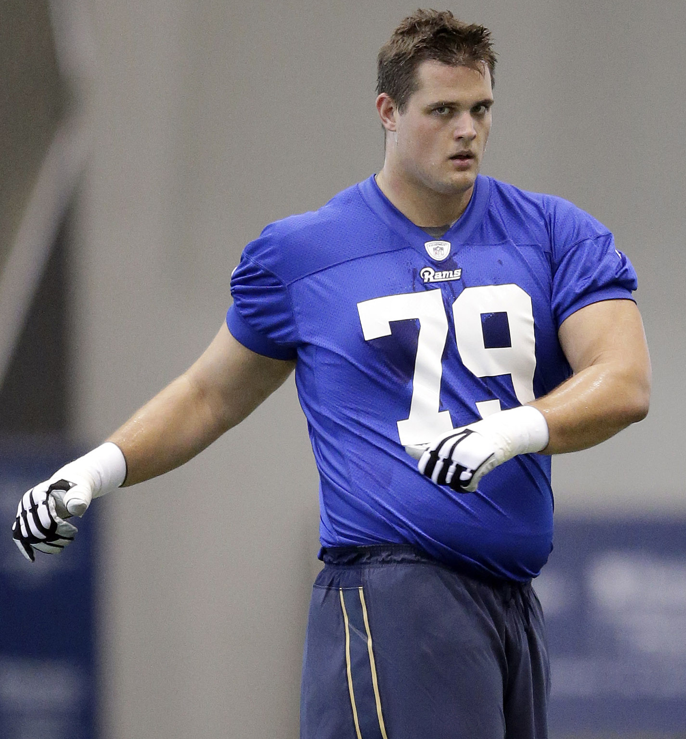 FILE - In this May 8, 2015, file photo, St. Louis Rams offensive tackle Rob Havenstein stretches during a rookie minicamp at the NFL football team's practice facility in St. Louis. The St. Louis Rams appear set to open the season with a pair of rookie off
