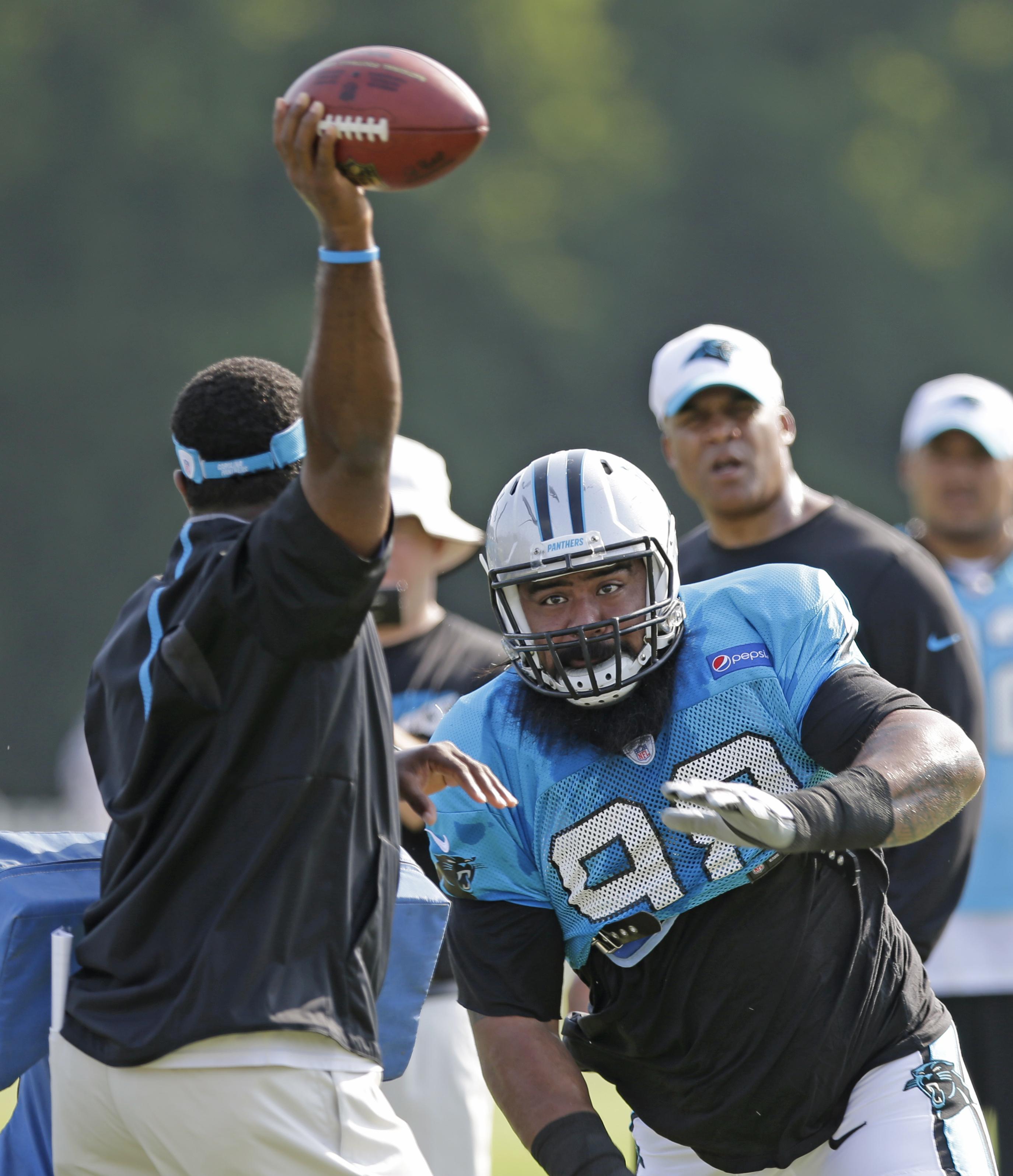 Carolina Panthers' Star Lotulelei (98) runs a drill during the NFL football team's training camp in Spartanburg, S.C., Monday, Aug. 3, 2015. (AP Photo/Chuck Burton)