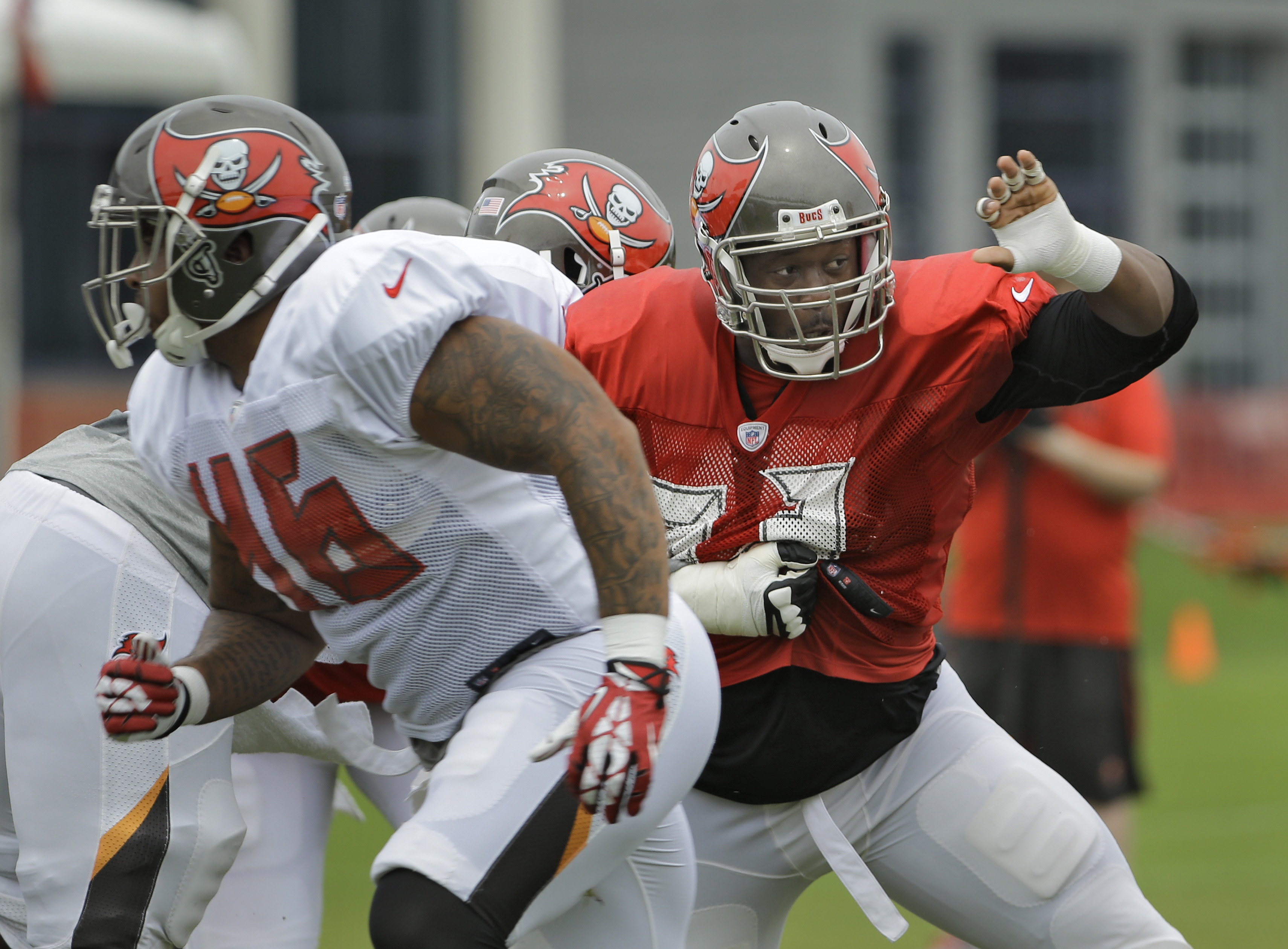 Tampa Bay Buccaneers defensive tackle Gerald McCoy, right, pressures the offense during a Buccaneers NFL football training camp practice Monday, Aug. 3, 2015, in Tampa, Fla. (AP Photo/Chris O'Meara)