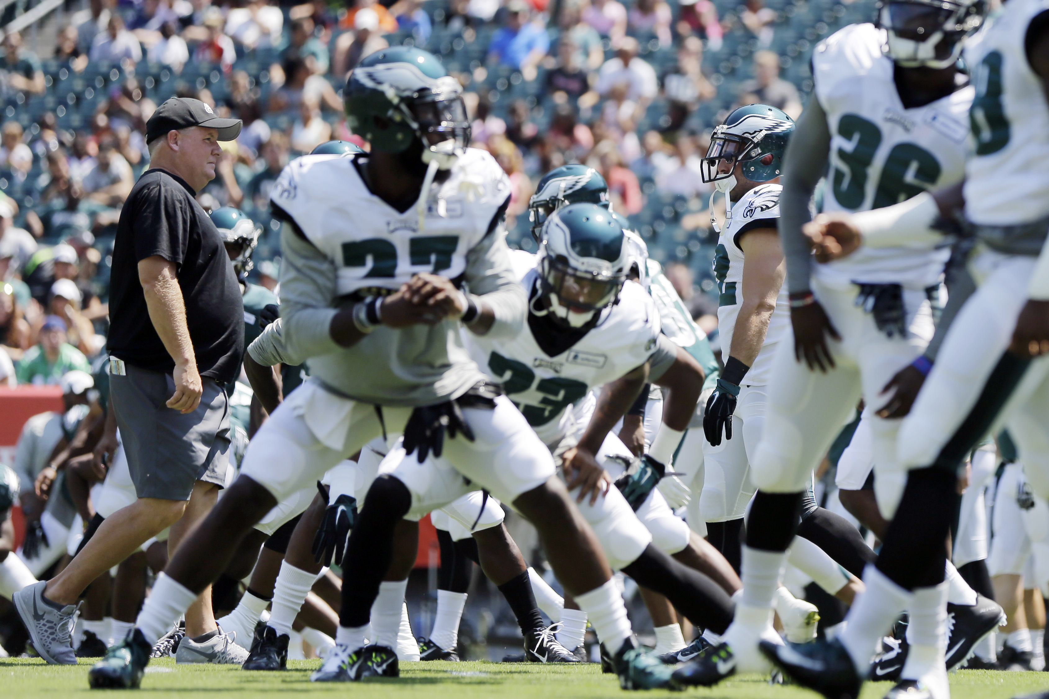 Philadelphia Eagles head coach Chip Kelly, left, walks the field during practice at NFL football training camp, Tuesday, Aug. 4, 2015, in Philadelphia. (AP Photo/Matt Rourke)