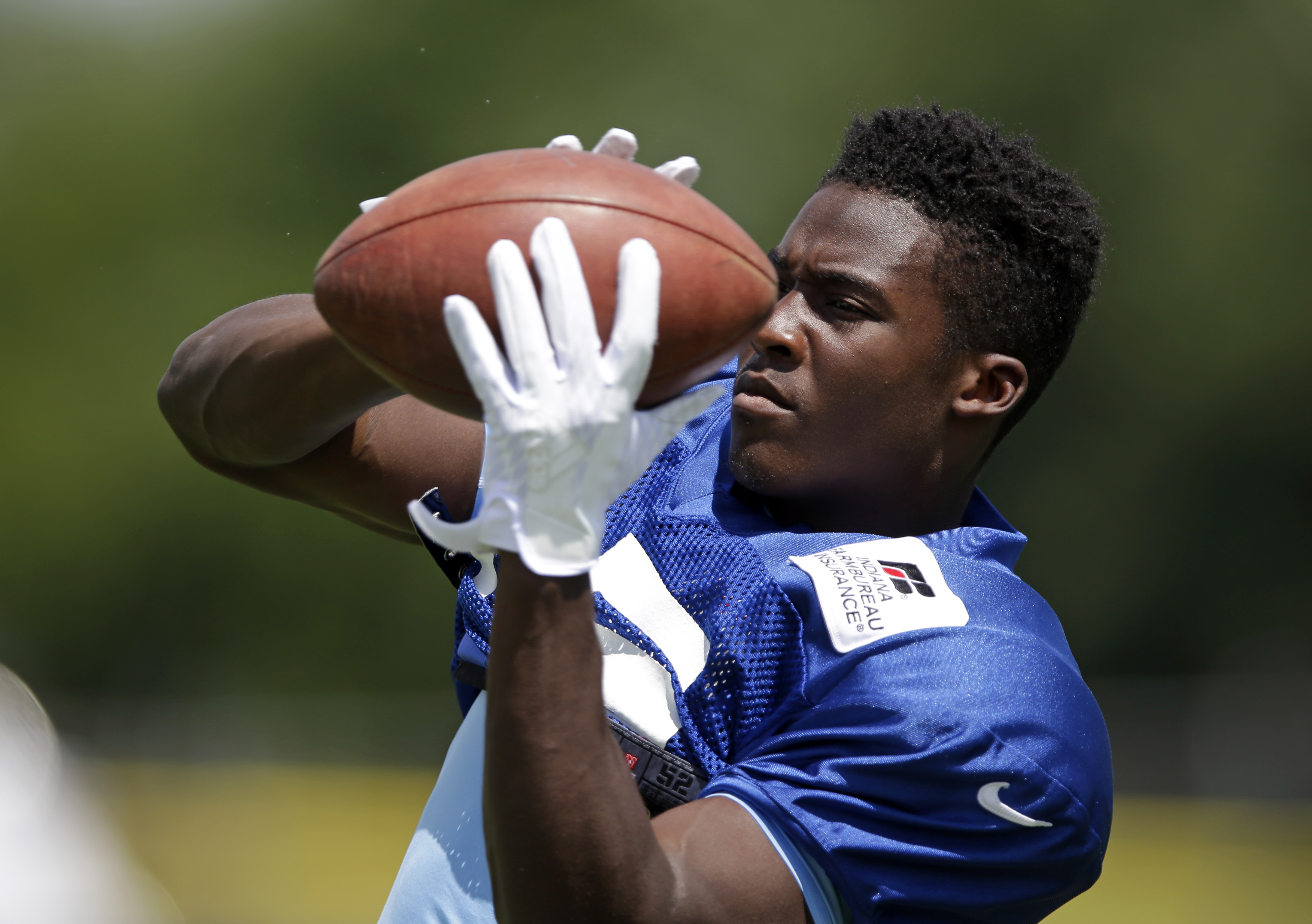 Indianapolis Colts wide receiver Phillip Dorsett (15) makes a catch during NFL football training camp in Anderson, Ind., Tuesday, Aug. 4, 2015.  (AP Photo/Michael Conroy)