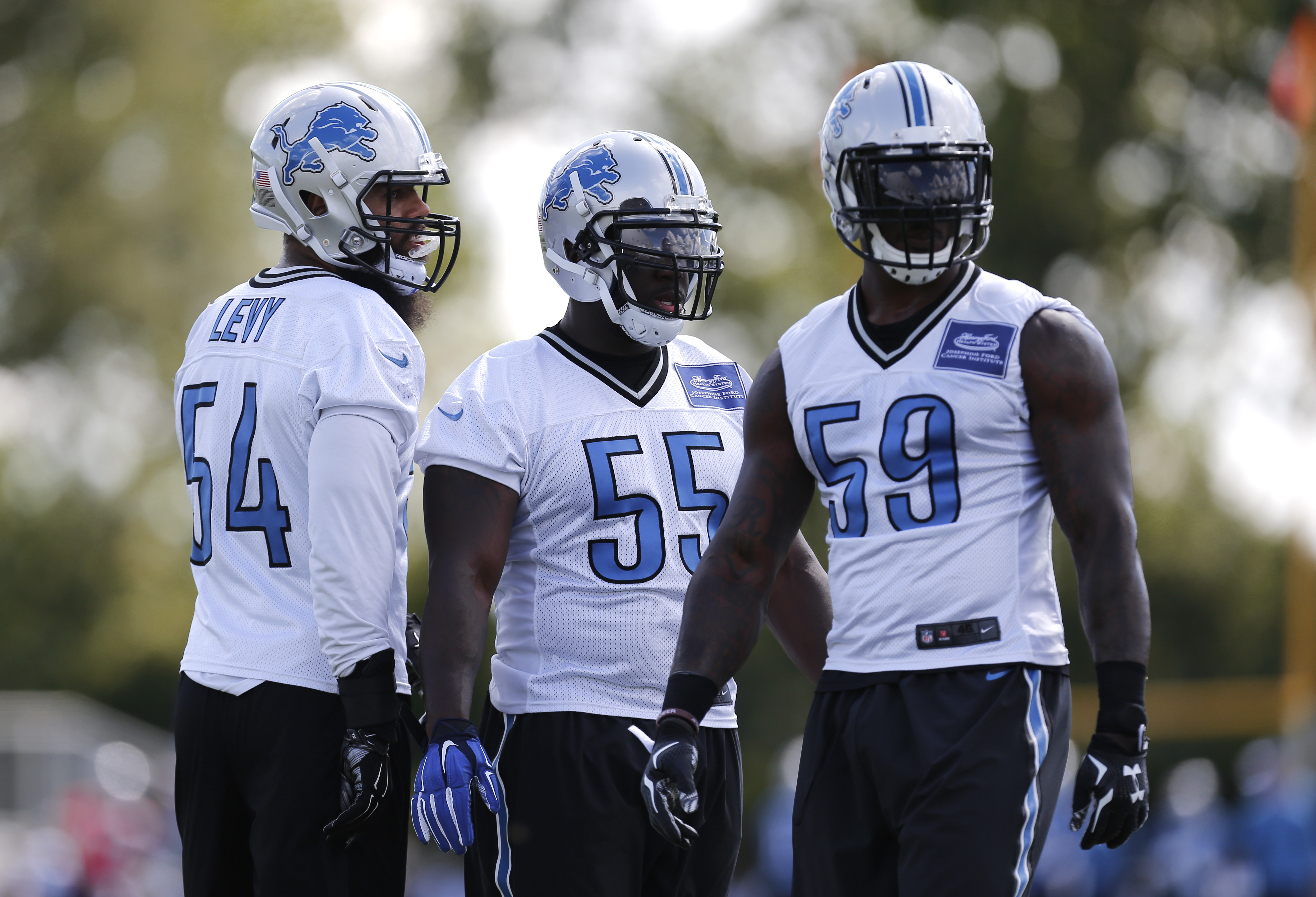 Detroit Lions linebackers DeAndre Levy, from left, Stephen Tulloch and Tahir Whitehead lineup during NFL football training camp in Allen Park, Mich., Tuesday, Aug. 4, 2015.  (AP Photo/Paul Sancya)
