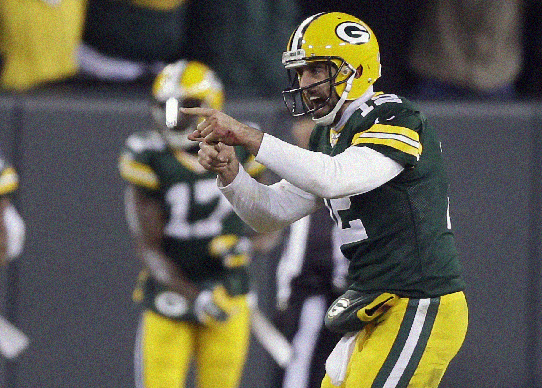 FILE - In this Nov. 30, 2014, file photo, Green Bay Packers quarterback Aaron Rodgers celebrates a 45-yard touchdown pass to Jordy Nelson during the first half of an NFL football game against the New England Patriots in Green Bay, Wis. With a healthy Rodg