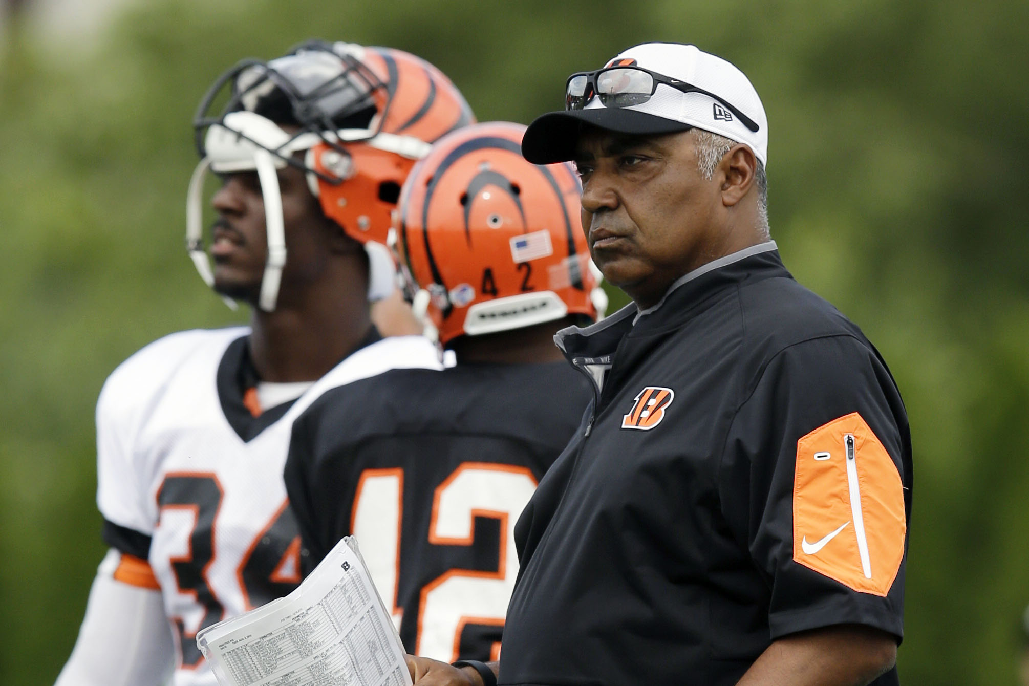 Cincinnati Bengals head coach Marvin Lewis watches during NFL football training camp, Tuesday, Aug. 4, 2015, in Cincinnati. (AP Photo/John Minchillo)
