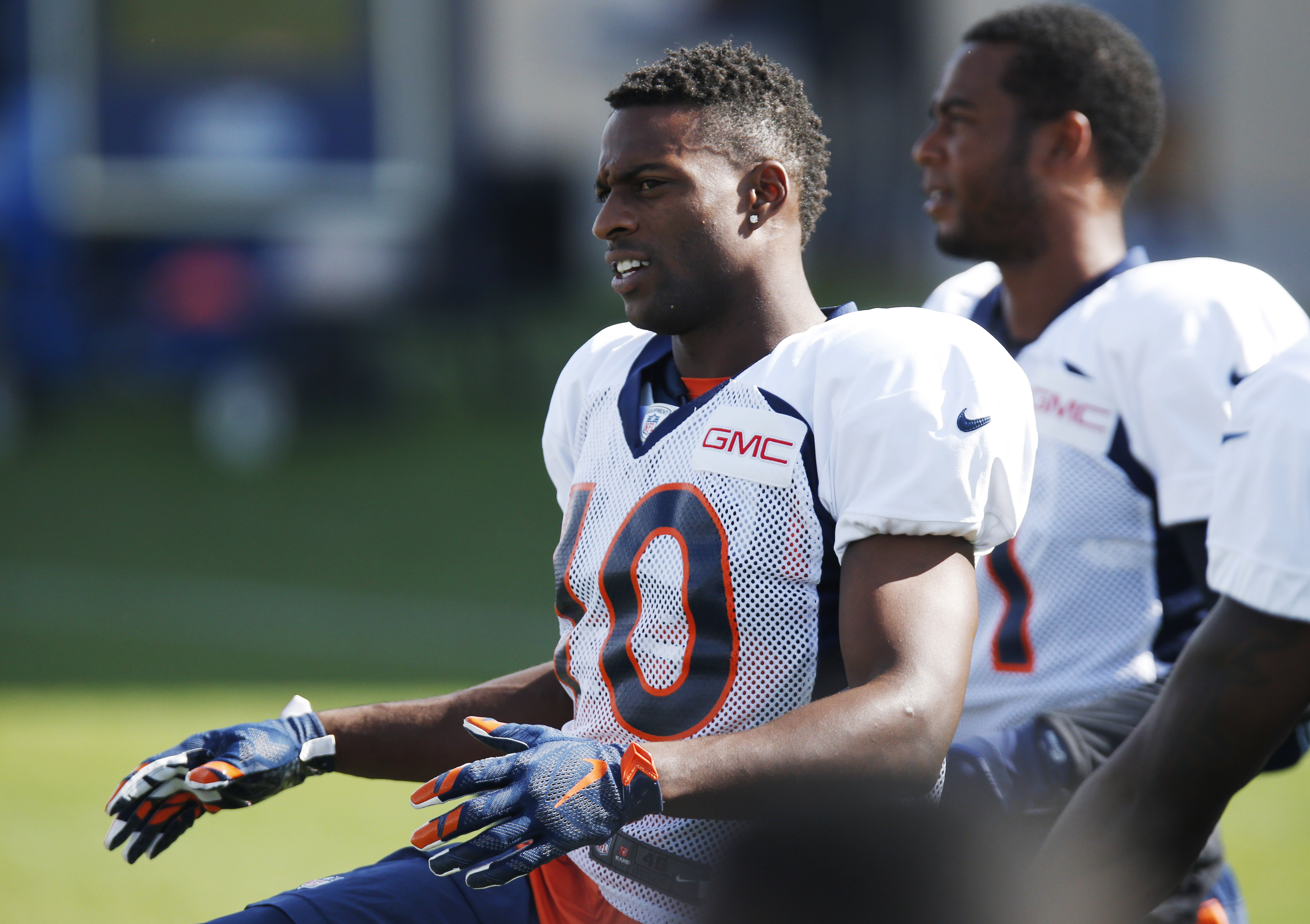 In this Sunday, Aug. 2, 2015, photo, Denver Broncos wide receiver Emmanuel Sanders stretches before taking part in the team's NFL football training camp in Englewood, Colo. Sanders was so eager to impress his new team and build a rapport with Peyton Manni